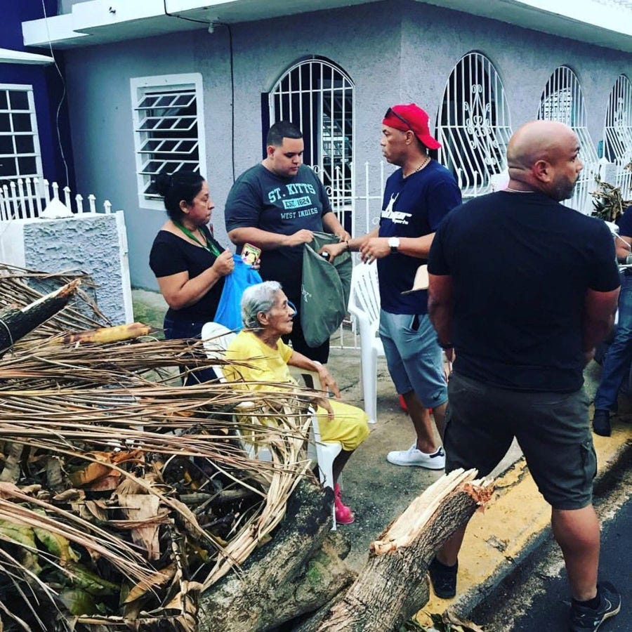 Major League Baseball Hall of Famer Roberto Alomar visits his hometown of Salinas, Puerto Rico, in this 2017 photo, handing out water, food and t-shirts to help relief efforts following the destruction of Hurricane Maria.