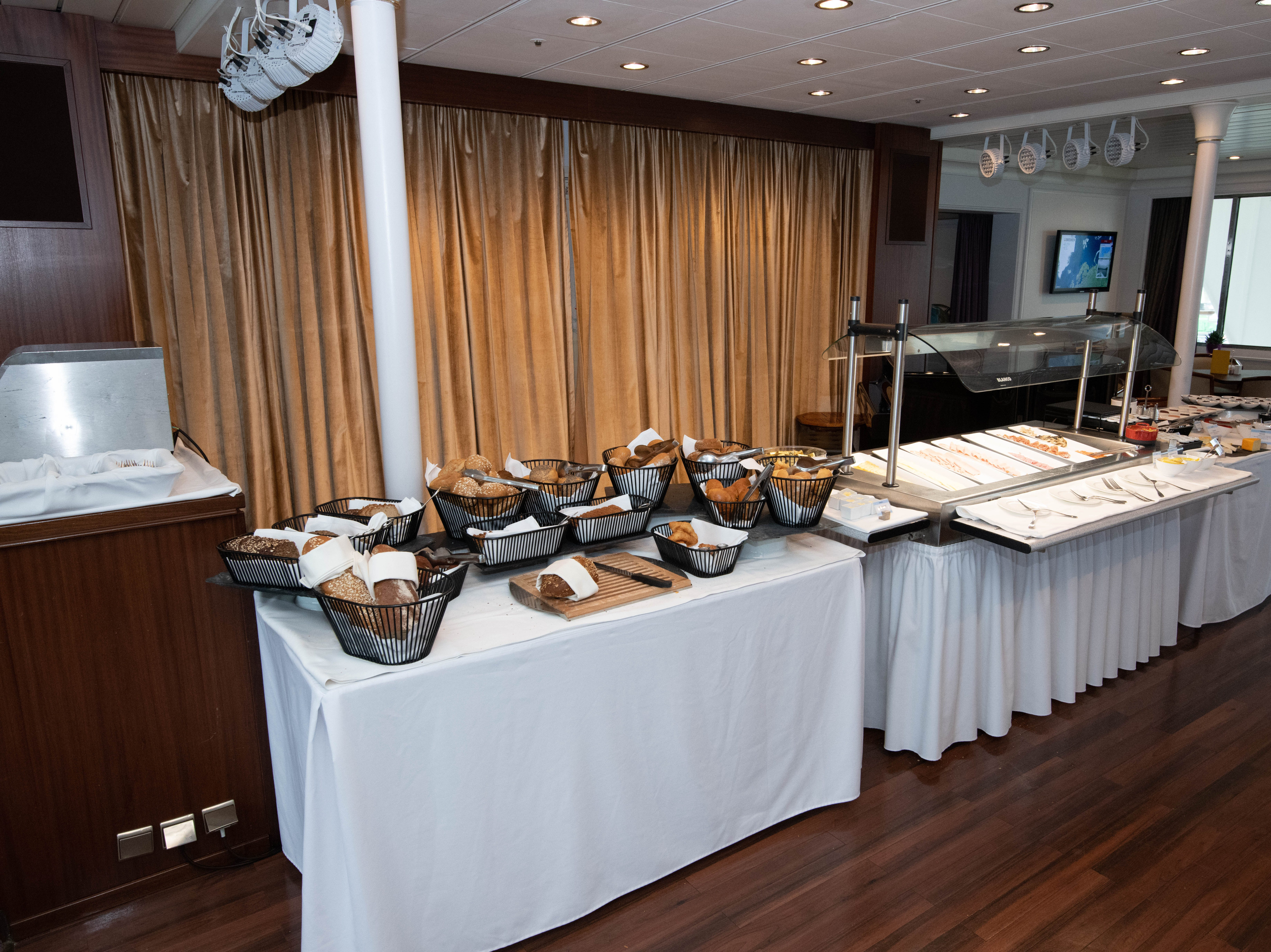 Buffet stations are set up in the dance floor area of the Bremen Club lounge during traditional breakfast and lunch times.