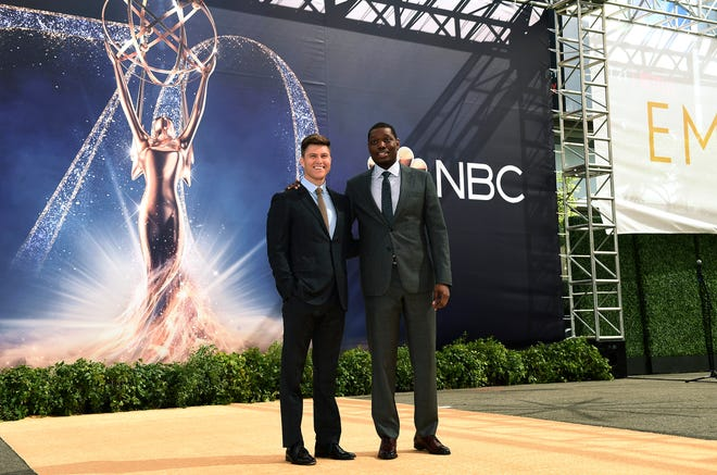 Colin Jost and Michael Che roll out the gold carpet for the 70th Emmy Awards at Microsoft Theater.