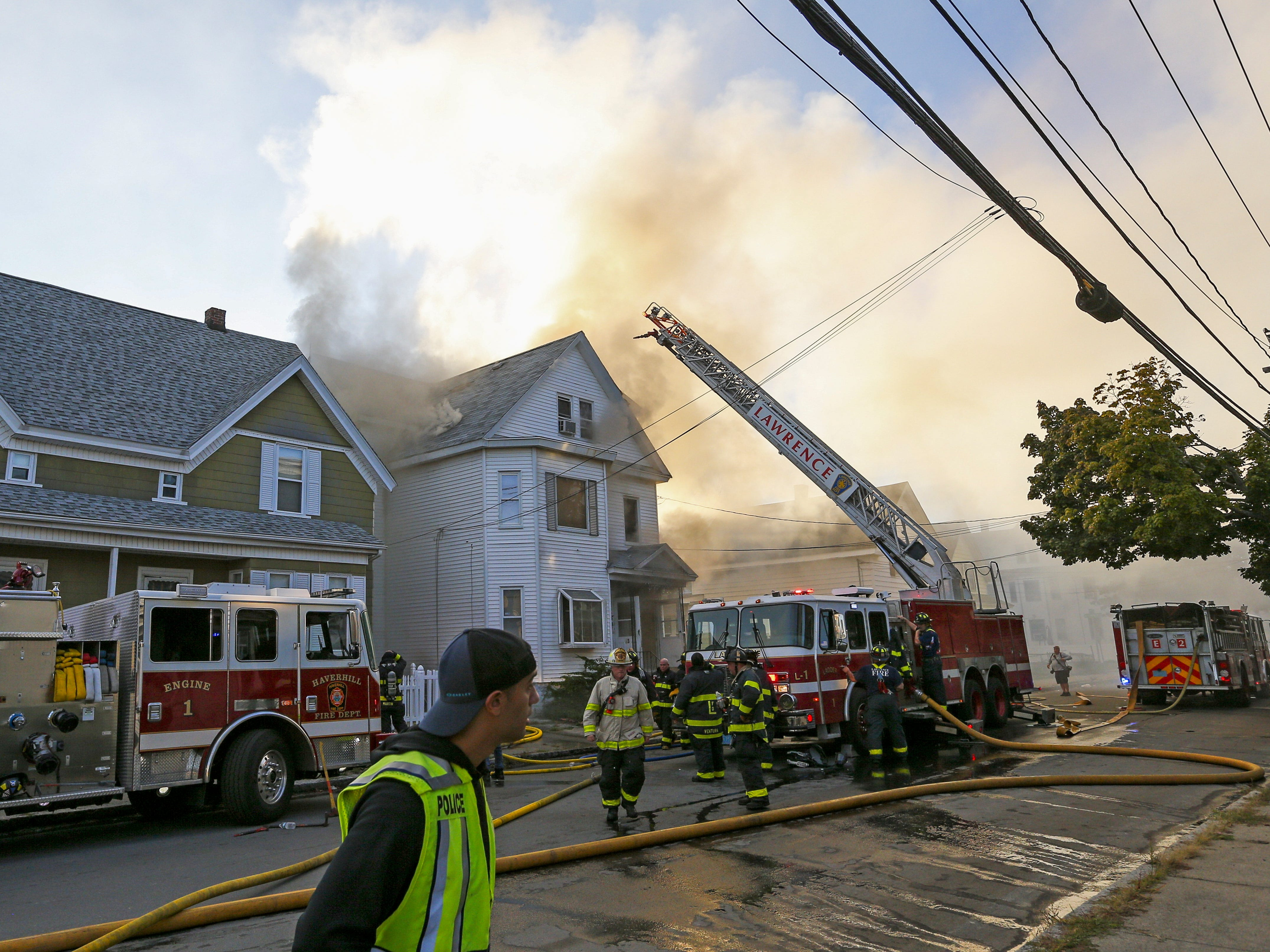 Firefighters battle a fire in a house in Lawrence, Mass. on Sept. 13 2018.