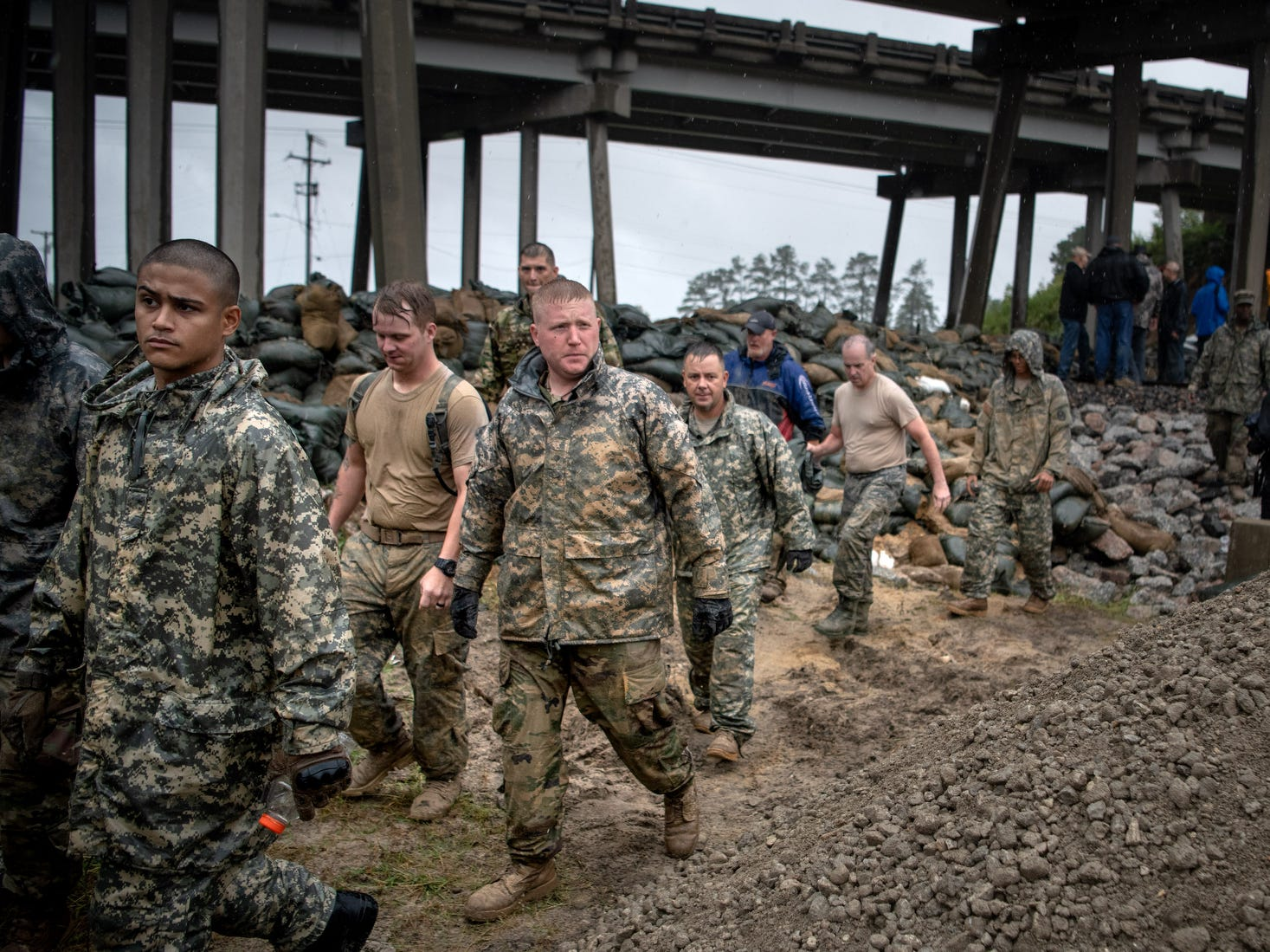 Soldiers from the North Carolina National Guard depart after reinforcing a low-lying area with sandbags as Hurricane Florence approaches Lumberton, N.C..