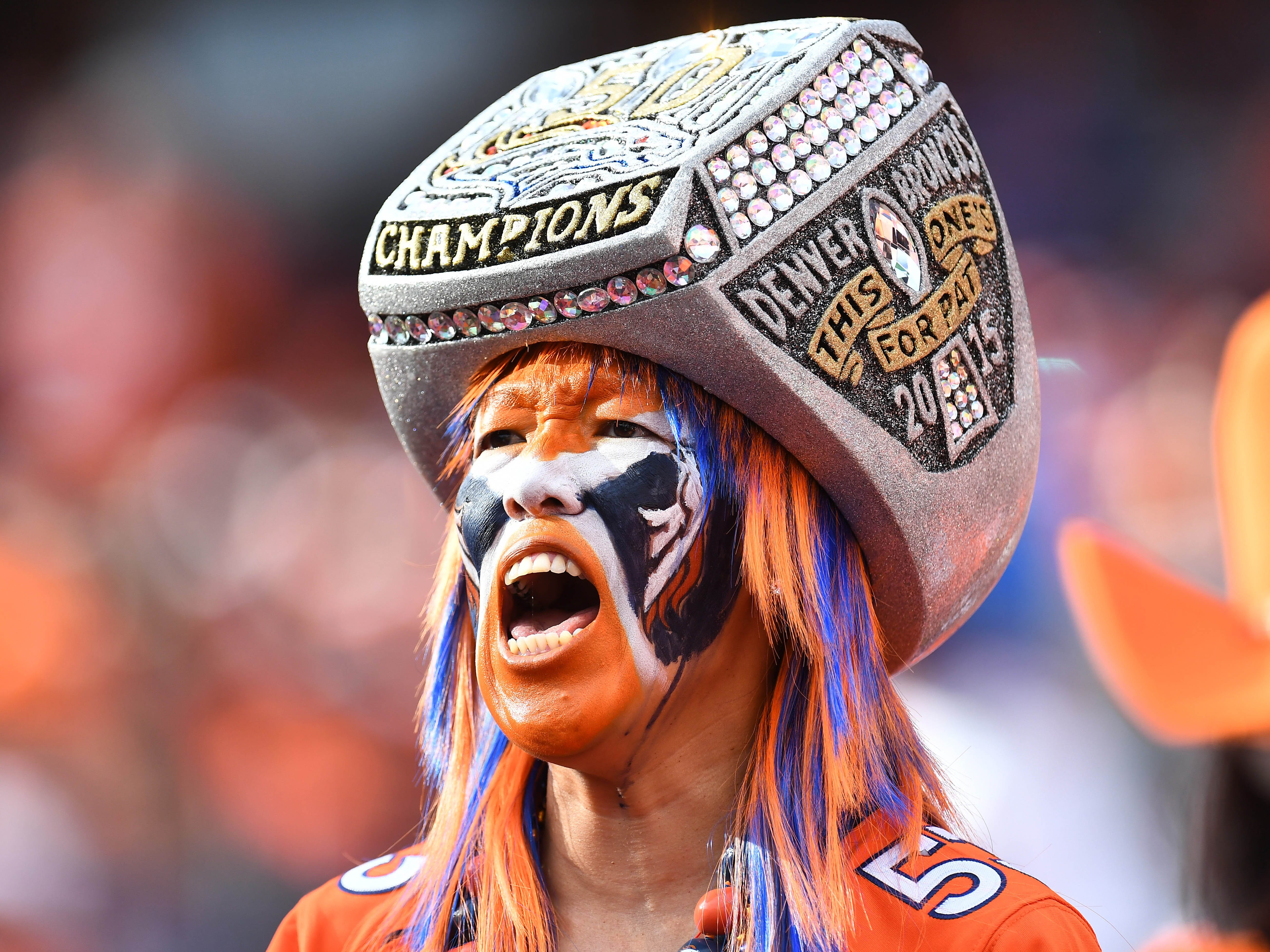 Sep 9, 2018; Denver, CO, USA; General view of a Denver Broncos fan wearing a super bowl ring against the Seattle Seahawks in the fourth quarter at Broncos Stadium at Mile High. Mandatory Credit: Ron Chenoy-USA TODAY Sports