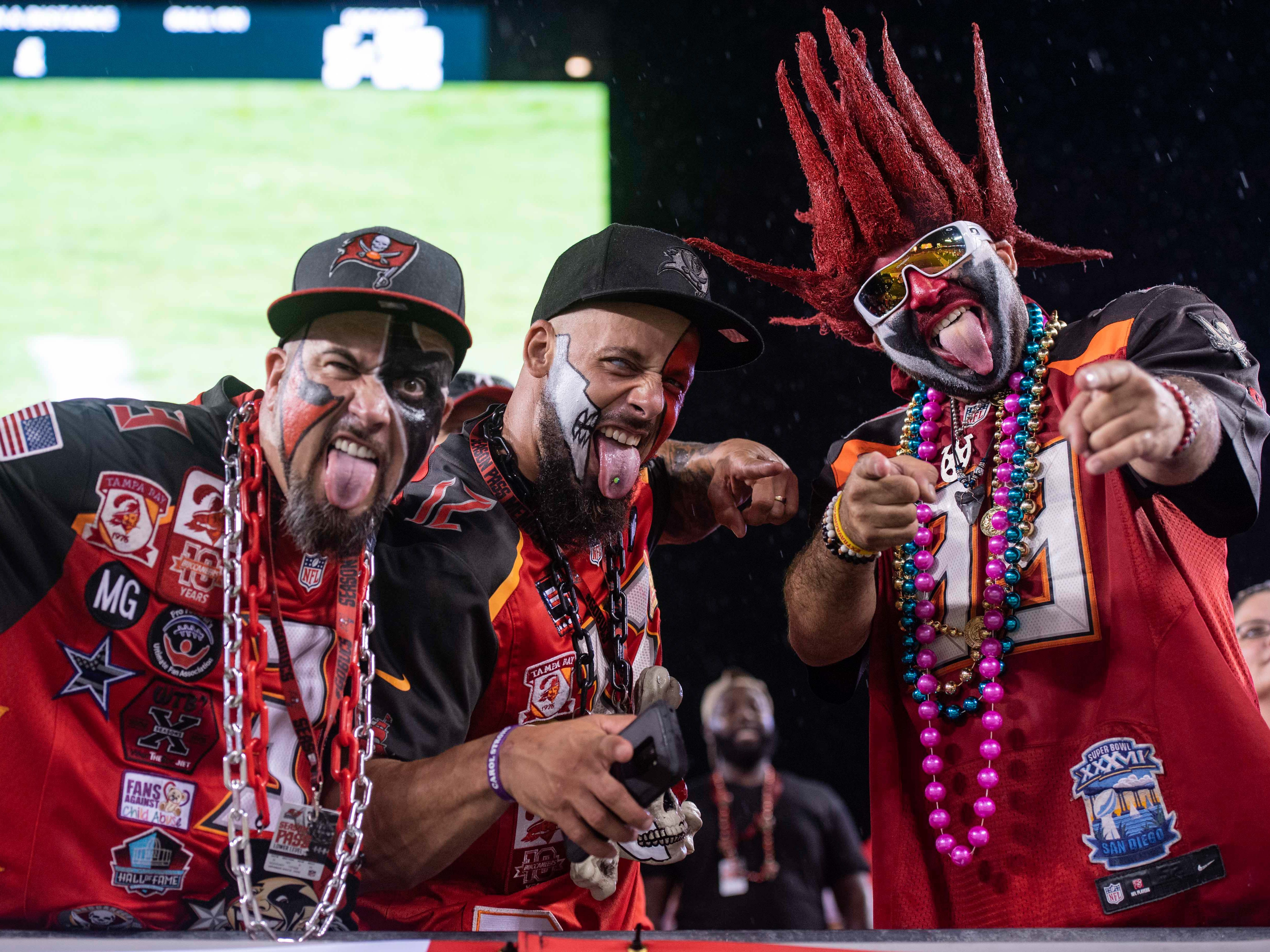Aug 24, 2018; Tampa, FL, USA; Fans dressed in costume cheer on the Tampa Bay Buccaneers during warmups prior to the game against the Detroit Lions at Raymond James Stadium. Mandatory Credit: Douglas DeFelice-USA TODAY Sports