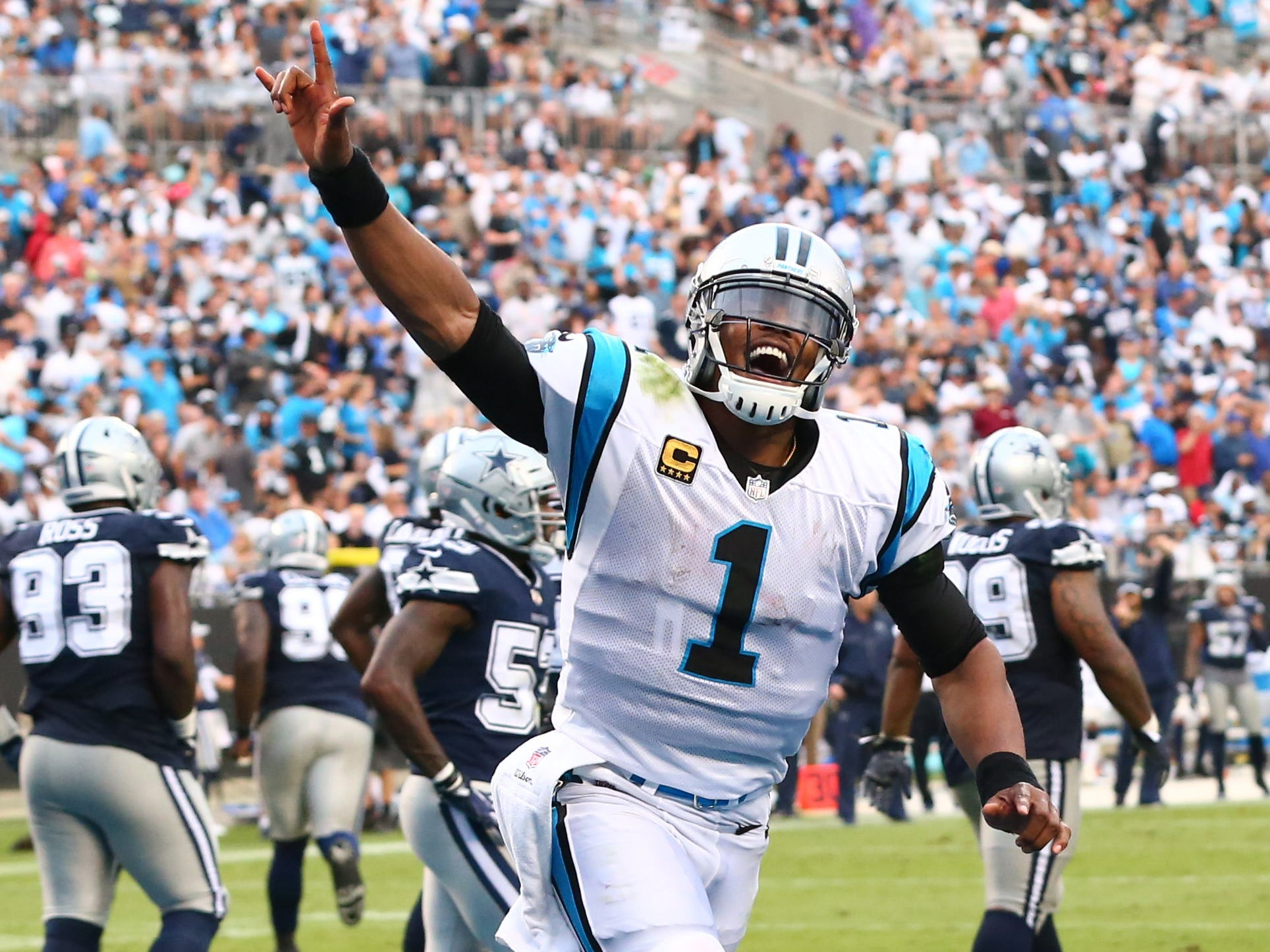 Cam Newton celebrates after a Carolina Panthers touchdown in the second half against the Dallas Cowboys at Bank of America Stadium.
