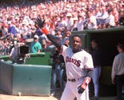 Barry Bonds waves to the crowd after hitting a home run in his first home at- bat at Candlestick Park on April 12, 1993.