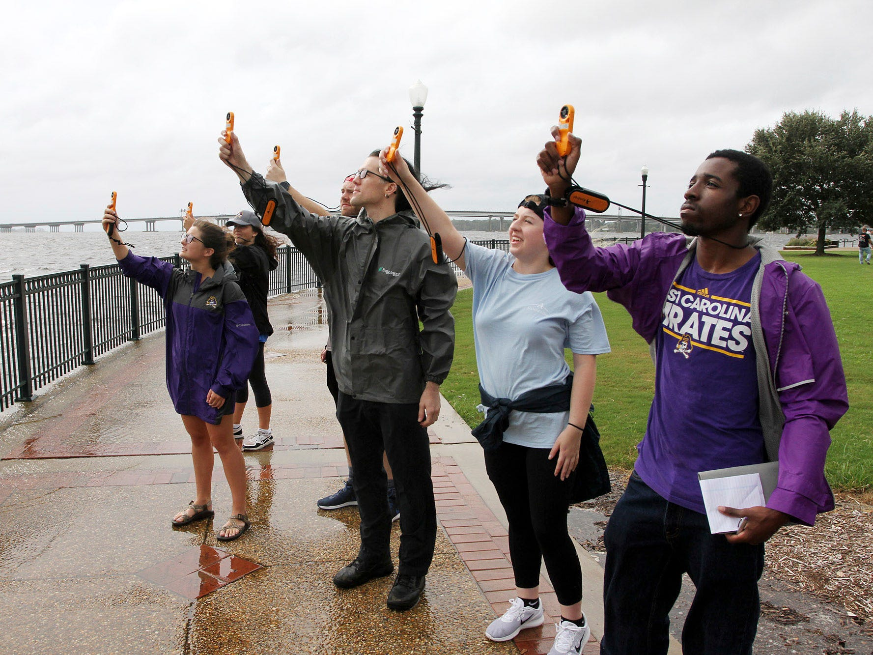 Students Samantha Levine, Megan Boles, Aaron Newns, Dana Pawlowski and Isaiah Goham, of East Carolina University's Coastal Storms class, use anemometers to measure wind speeds at Union Point Park in New Bern, N.C. Sept. 13, 2018.