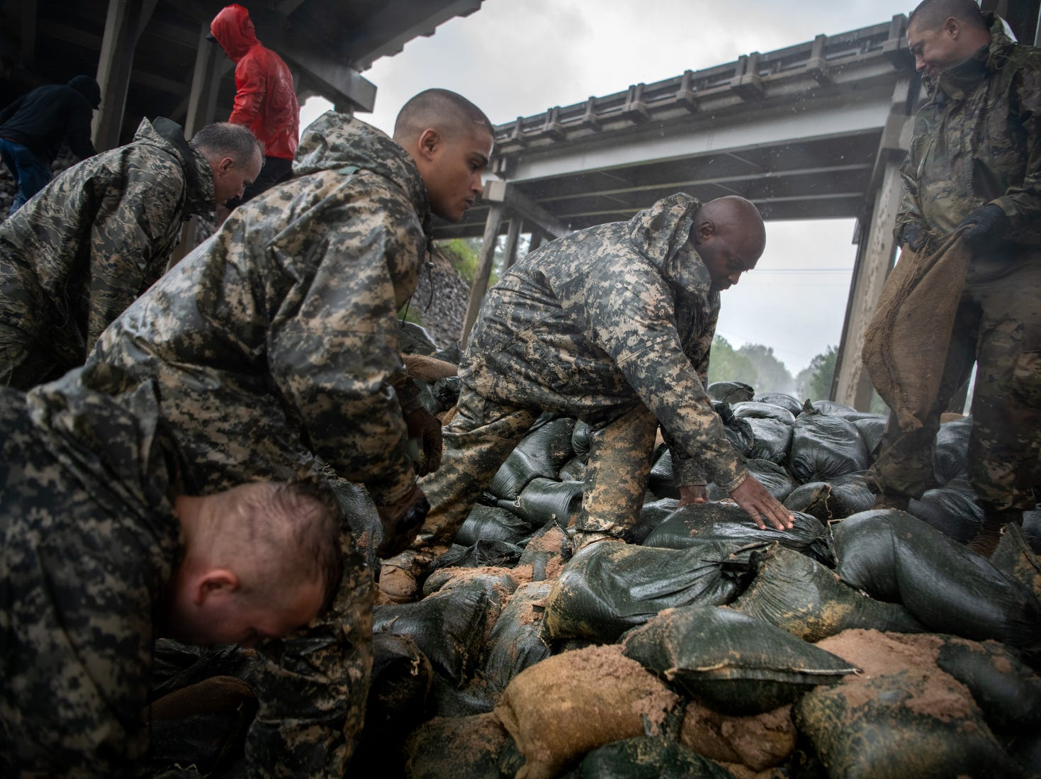 Soldiers from the North Carolina National Guard reinforce a low-lying area with sandbags as Hurricane Florence approaches Lumberton, N.C., Friday.