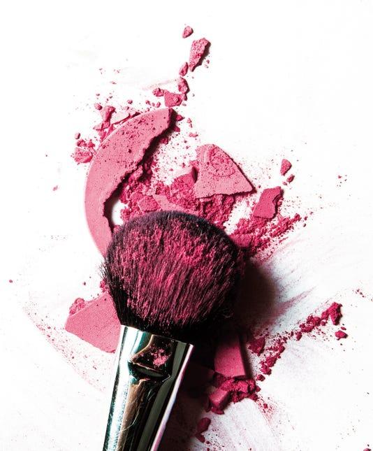 Crushed Pink Eyeshadow And Make Up Brush