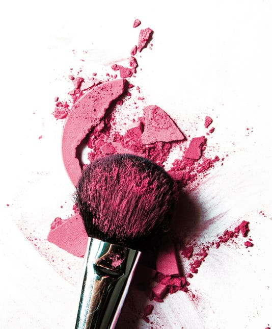 Crushed Pink Eyeshadow And Make Up Brush