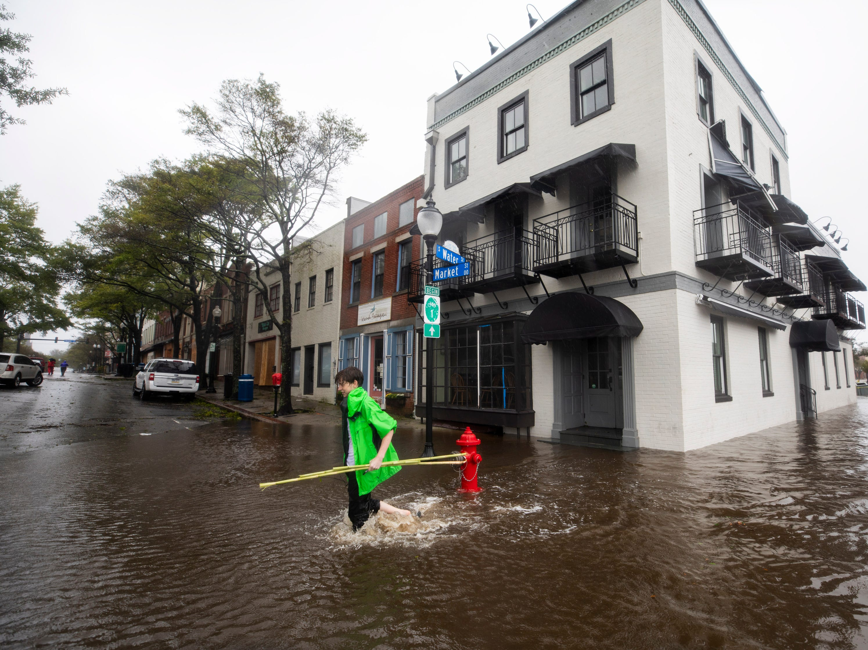 Sam Parks walks through flooded Water Street as Hurricane Florence comes ashore in Wilmington, N.C.