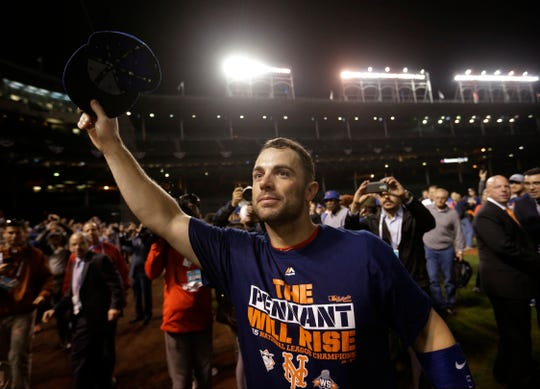 Oct. 21, 2015: David Wright waves to the crowd after the Mets win Game 4 of the NLCS against the Chicago Cubs to advance to the World Series.