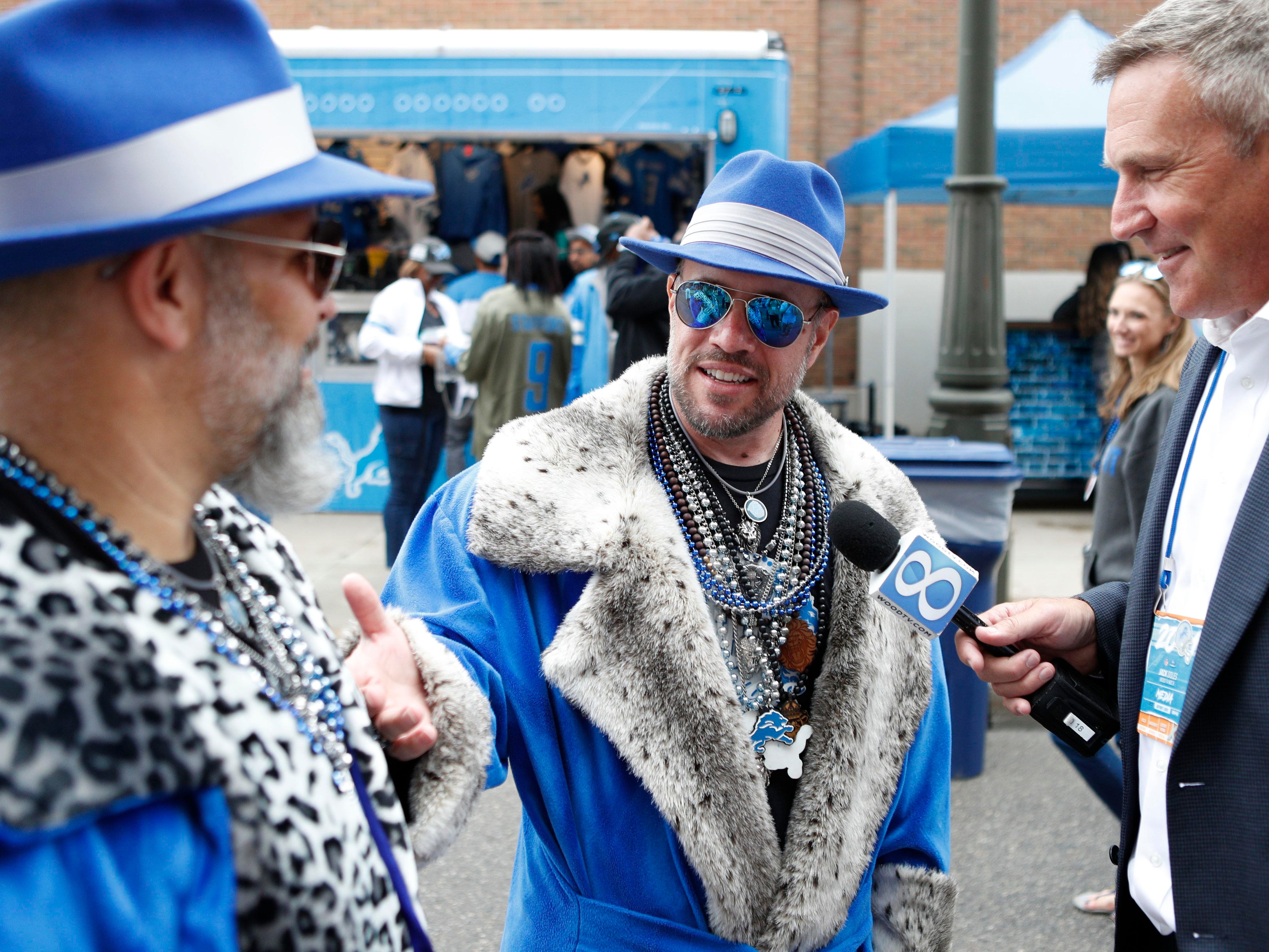 Sep 10, 2018; Detroit, MI, USA; Detroit Lions fans get interviewed by Jack Doles before the game against the New York Jets outside Ford Field. Mandatory Credit: Raj Mehta-USA TODAY Sports