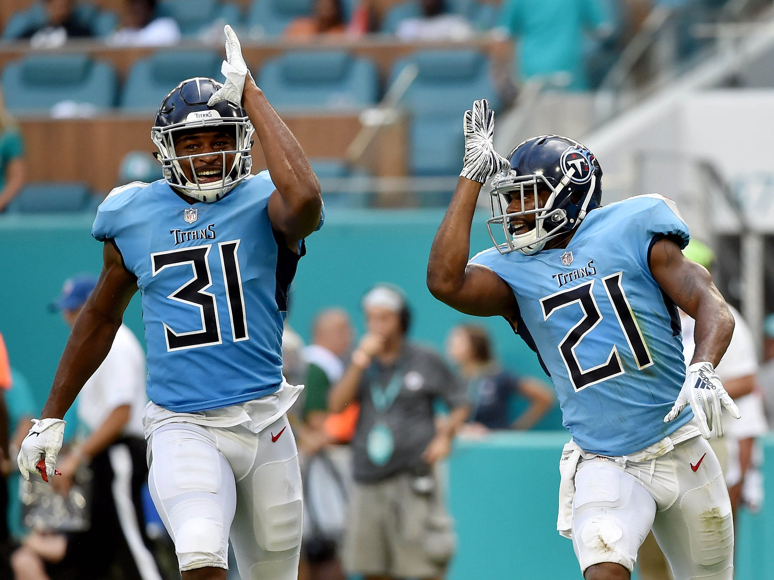 Tennessee Titans defensive back Malcolm Butler (right) celebrates  with teammate Kevin Byard (31) after making an interception during the second half against the Miami Dolphins at Hard Rock Stadium.