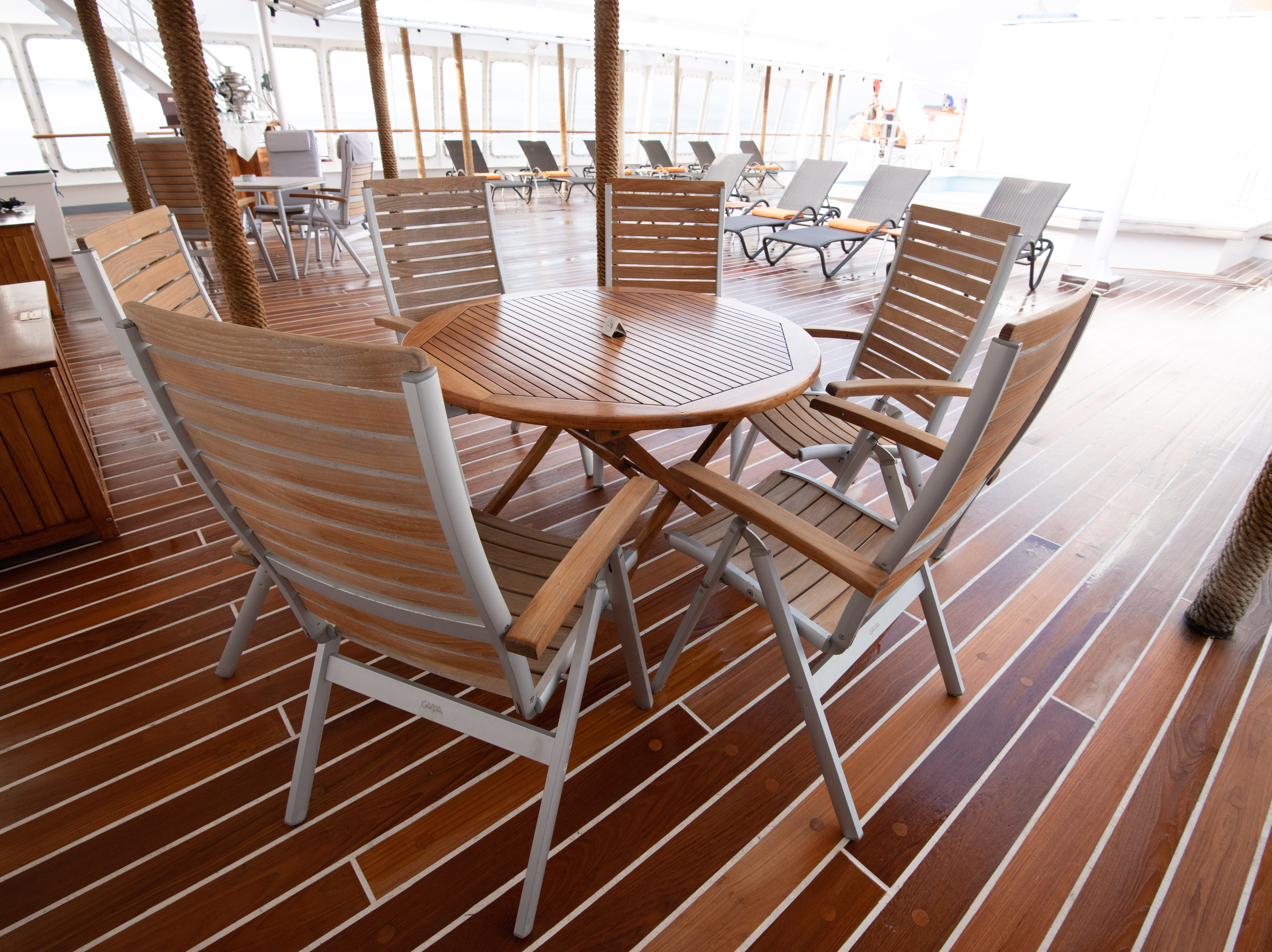 Bremen's Sun Deck also has a small seating area with chairs and tables.