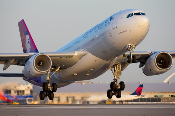 A Hawaiian Airlines Airbus A330 takes off for Honolulu from Los Angeles International Airport on Sept. 23, 2017.
