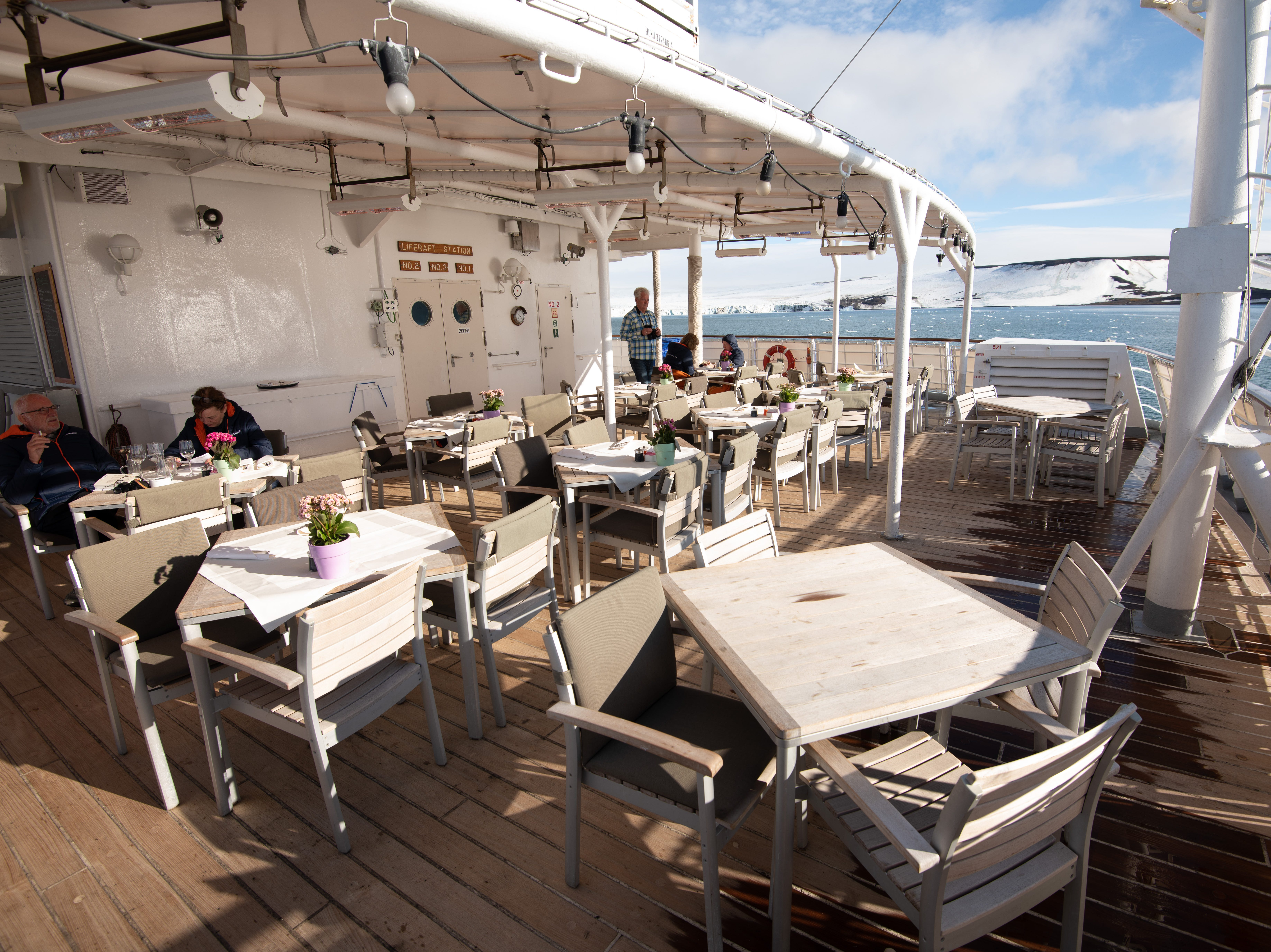 At the back of Bremen on Deck 5, just behind the Bremen Club lounge, is an outdoor area with seating called the Lido Deck.