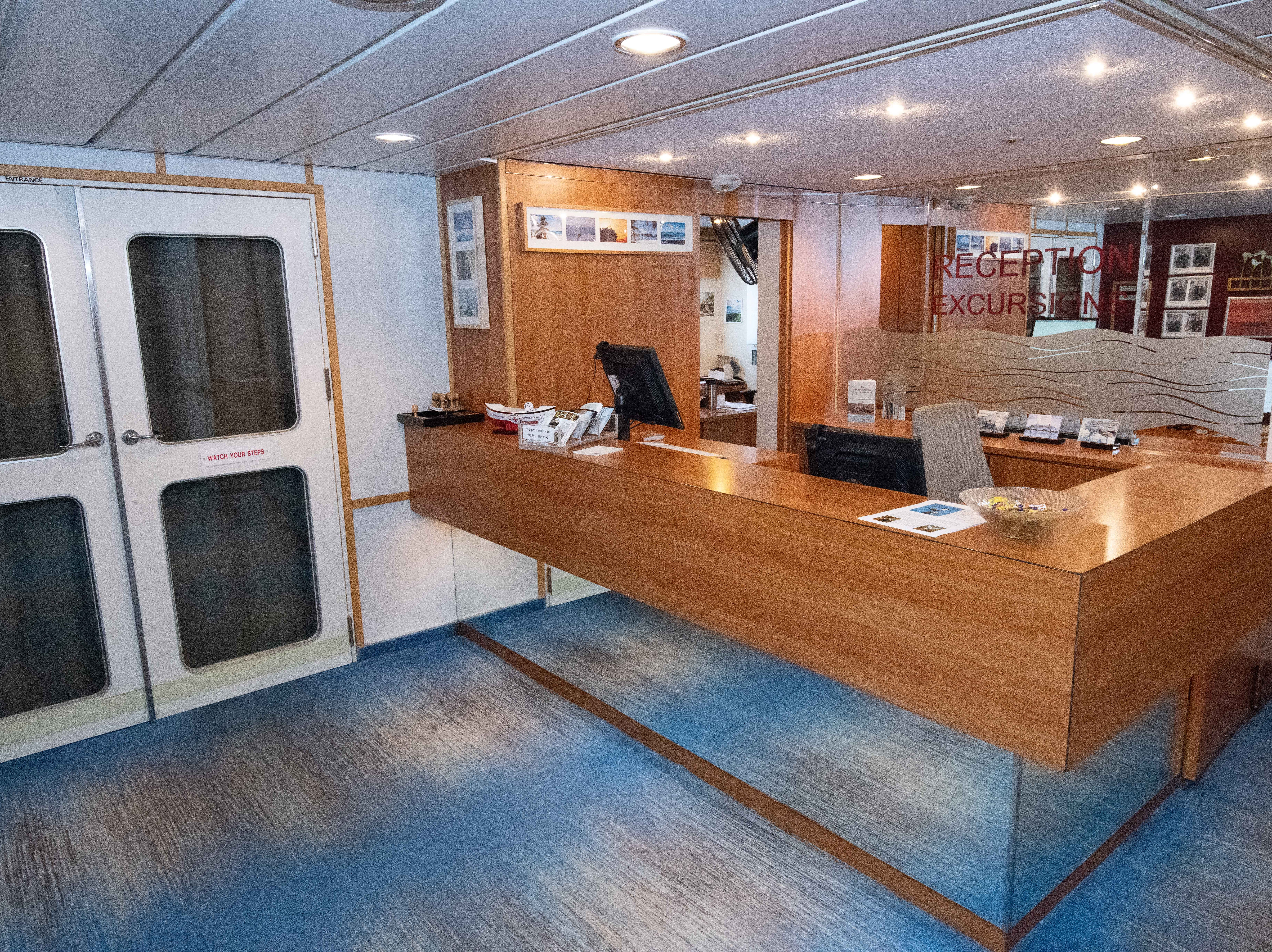A reception desk is located on Deck 4.