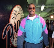 Fred McGriff, who was traded to the Braves in July 1993, was a key factor in Atlanta's NL West crown that year. He heads to the Padres locker room for the final time after the deal was announced.
