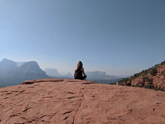 "A woman meditates near the Sedona, Arizona, airport, believed to be the site of a powerful ""upflow"" energy vortex."
