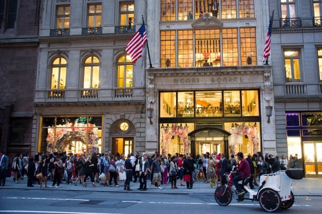 Shoppers gather outside the Henri Bendel store on Fifth Avenue during Fashion's Night Out in New York on Sept. 8, 2011.