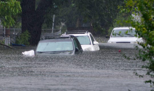 September 14, 2018; Washington Park, NC, USA; Hurricane Florence brought enough rain to cover the cars parked on 6th St in Washington, N.C. to be covered over the hood with water on Friday afternoon on September 14, 2018.