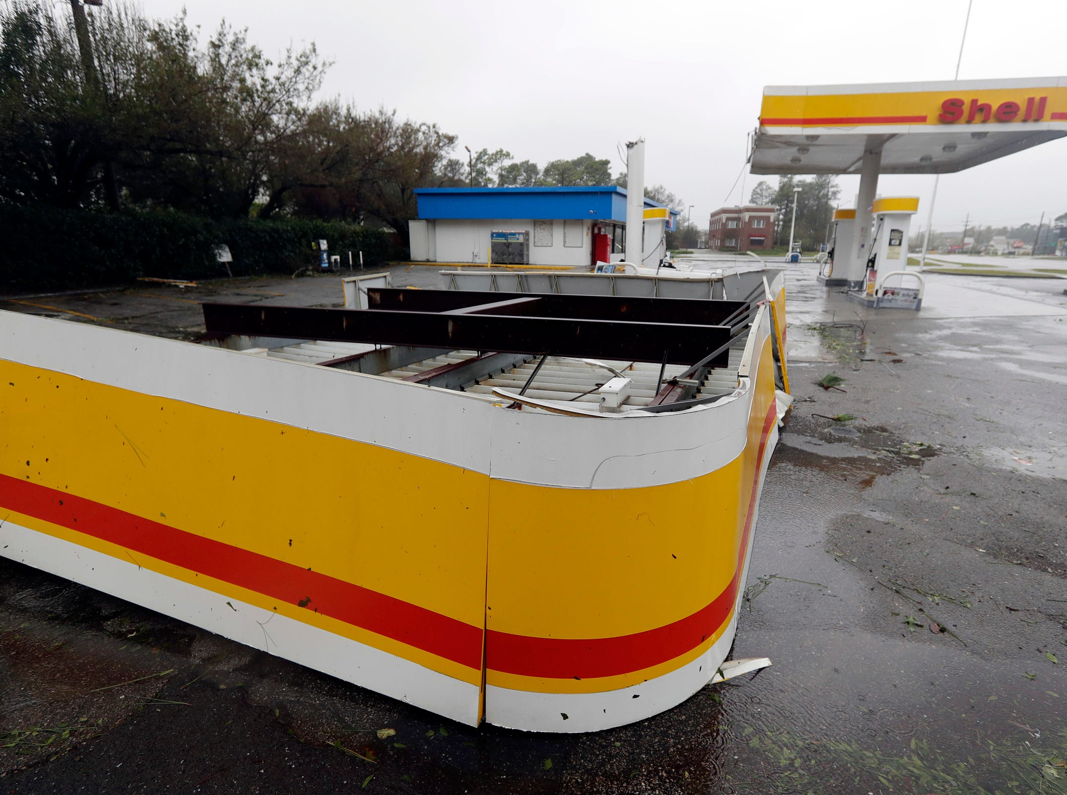 The shelter of a gas station lies on the ground in Wilmington, N.C., after Hurricane Florence made landfall Friday.