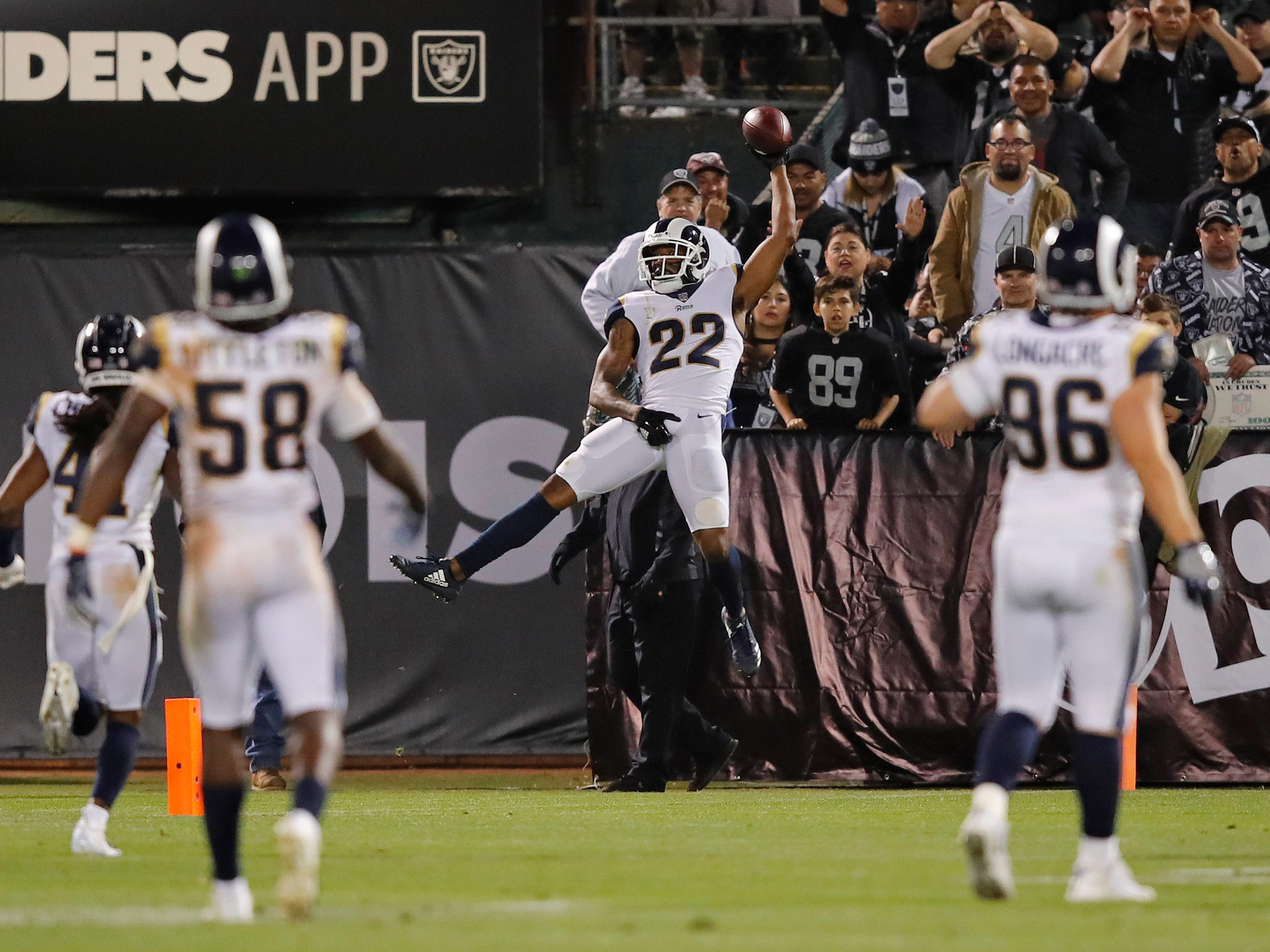 Los Angeles Rams cornerback Marcus Peters celebrates in the end zone after  a 50-yard interception for a touchdown against the Oakland Raiders.
