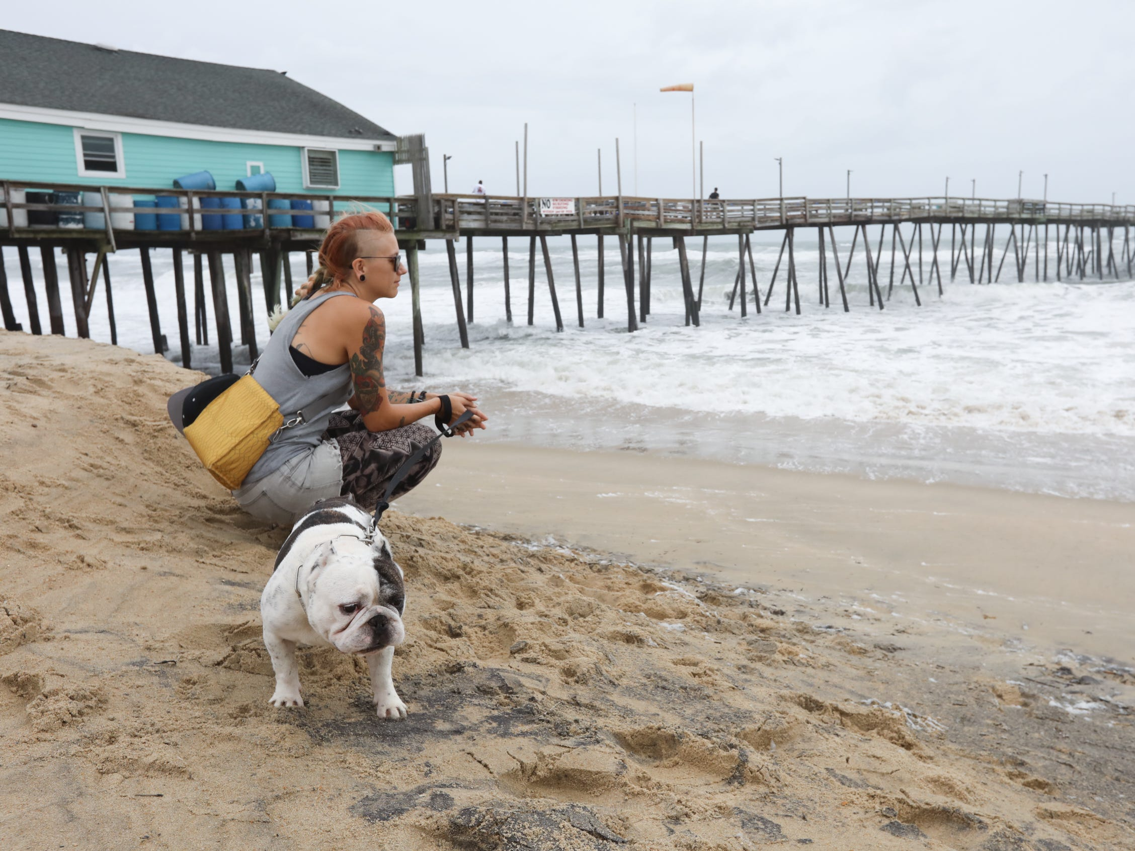 Amanda Daniels and her dog Dude on the beach in Kill Devil Hills, North Carolina on Sept. 14, 2018.