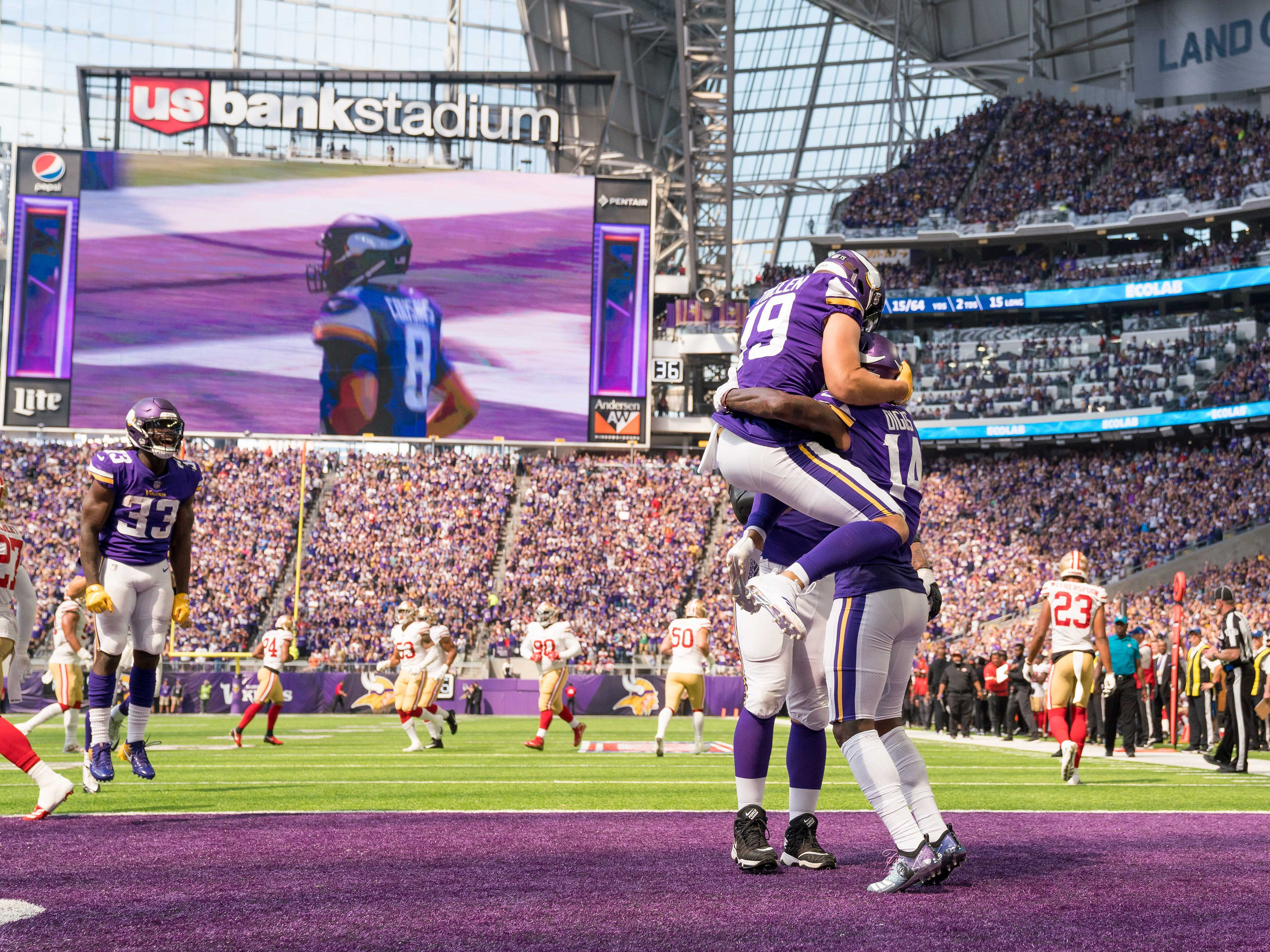 Minnesota Vikings wide receiver Adam Thielen (19) celebrates with teammate Stefon Diggs after his touchdown in the second quarter against San Francisco 49ers at U.S. Bank Stadium.