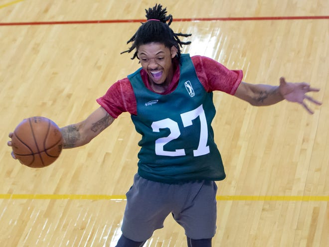 Eric Williams comes down with a rebound while trying out for the Wisconsin Herd on Saturday at the Oshkosh YMCA.