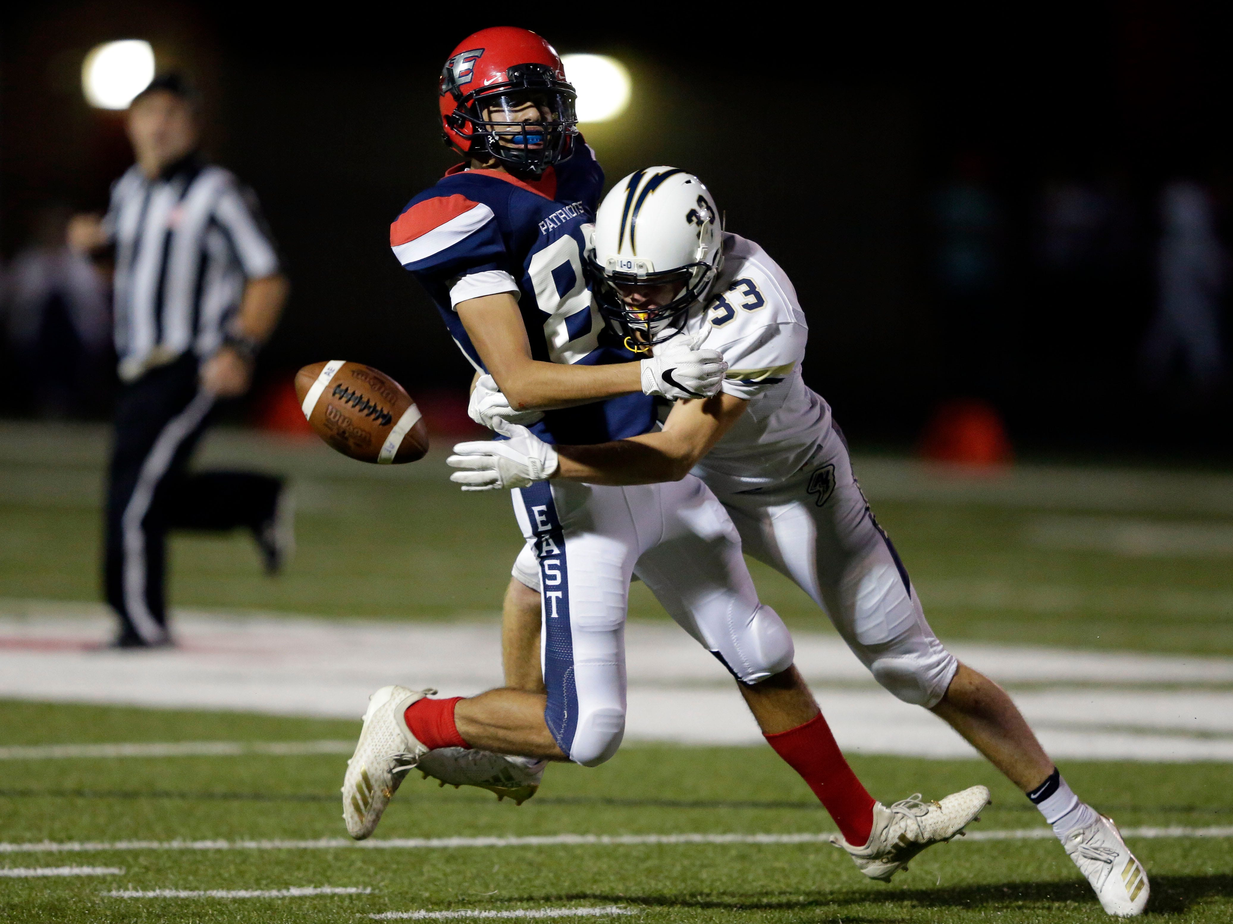 Mario Mendoza of Appleton East is tackled by Devin Blom of Appleton North as a pass falls incomplete in a Valley Football Association game Friday, September 14, 2018, at Appleton East High School in Appleton, Wis.Ron Page/USA TODAY NETWORK-Wisconsin