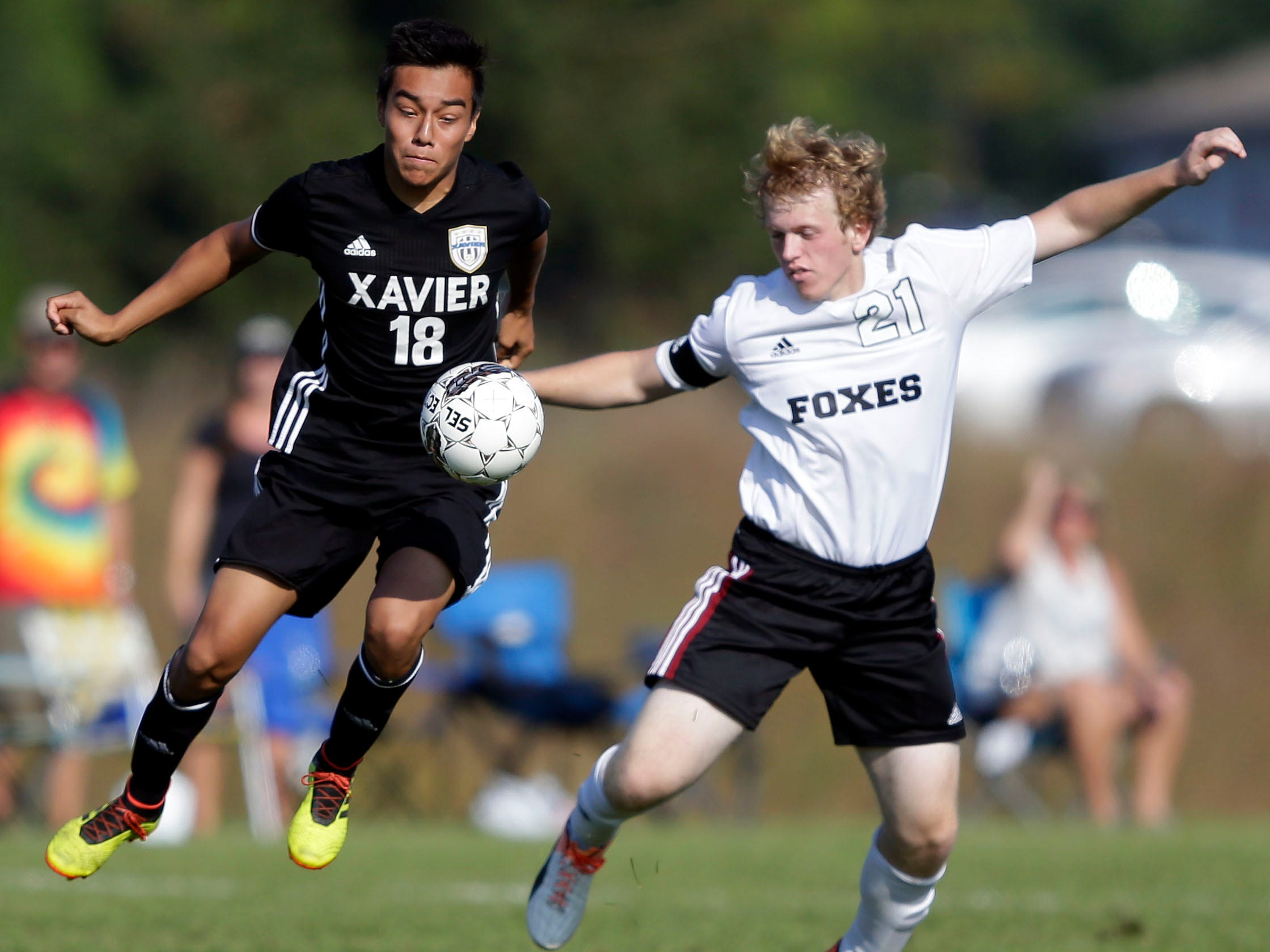 Adrian Chenci of Xavier and Ryan Blobe of Fox Valley Lutheran work for control in the Xavier boys soccer tournament Saturday, September 15, 2018, at the Scheels USA Sports Complex in Appleton, Wis.