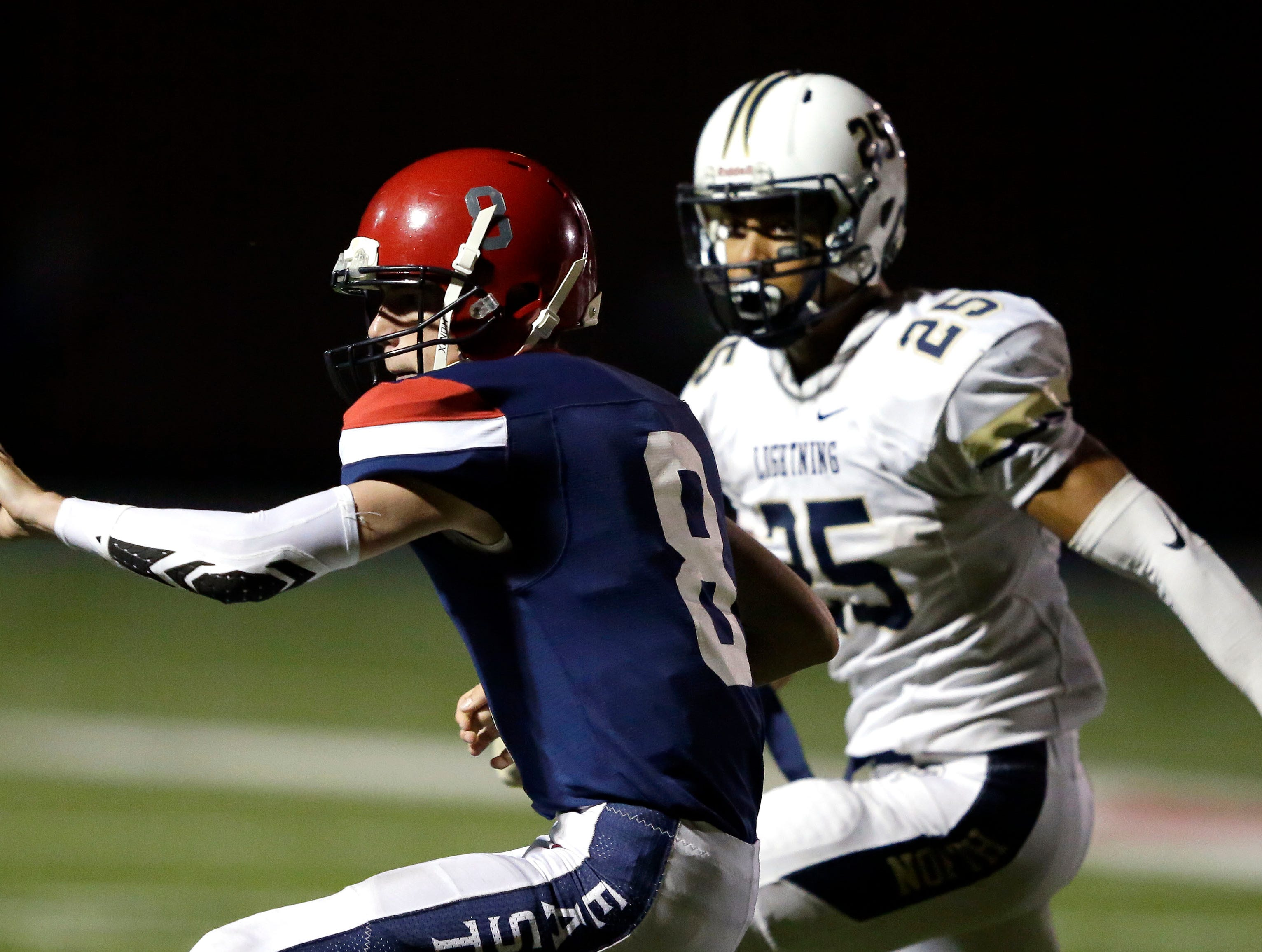 Ryan Latour of Appleton East pitches the ball as Terrell Williams of Appleton North closes in a Valley Football Association game Friday, September 14, 2018, at Appleton East High School in Appleton, Wis.Ron Page/USA TODAY NETWORK-Wisconsin