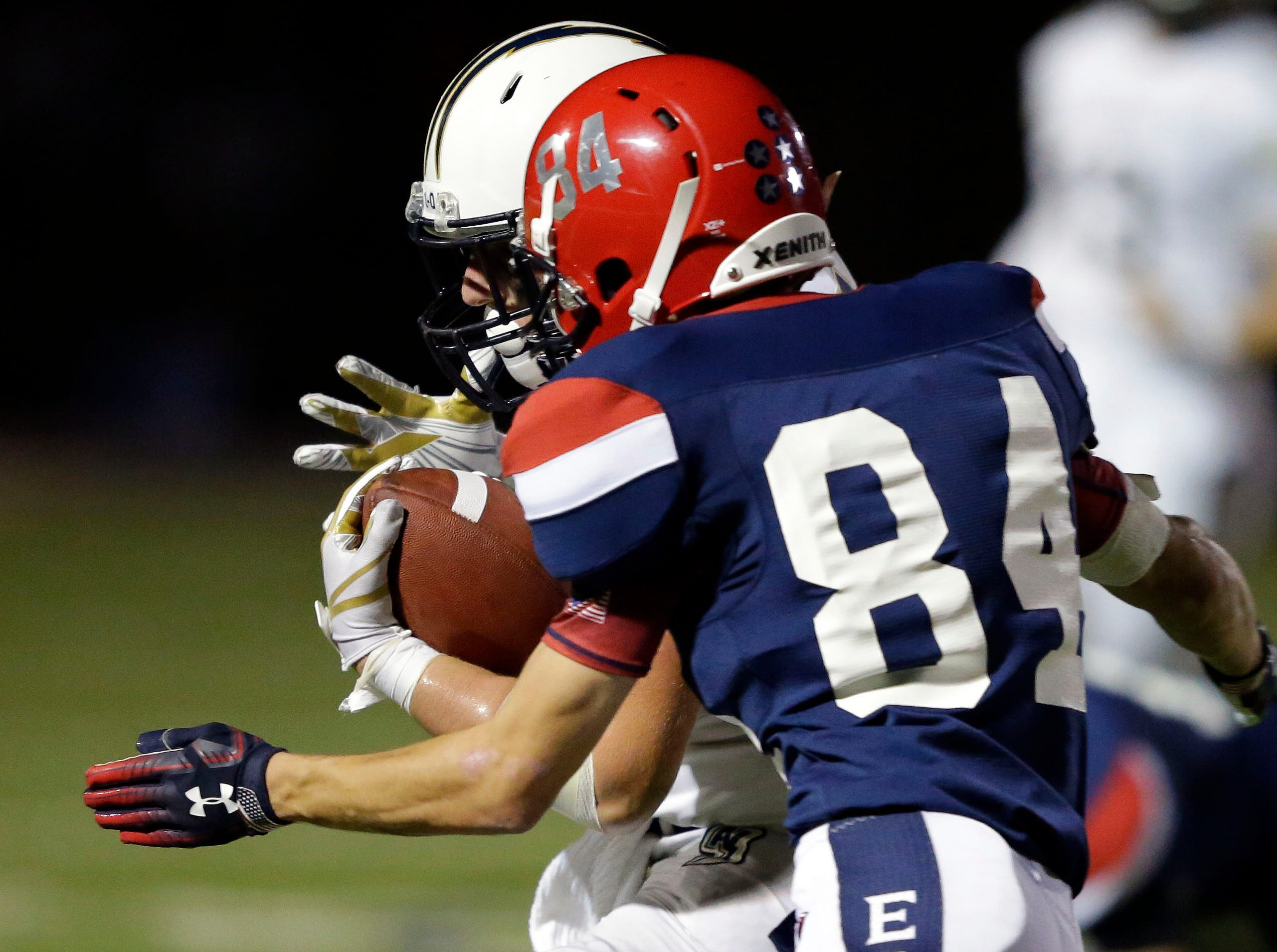 Ryan Balck of Appleton North carries the ball against Alex Weyenberg of Appleton East in a Valley Football Association game Friday, September 14, 2018, at Appleton East High School in Appleton, Wis.Ron Page/USA TODAY NETWORK-Wisconsin