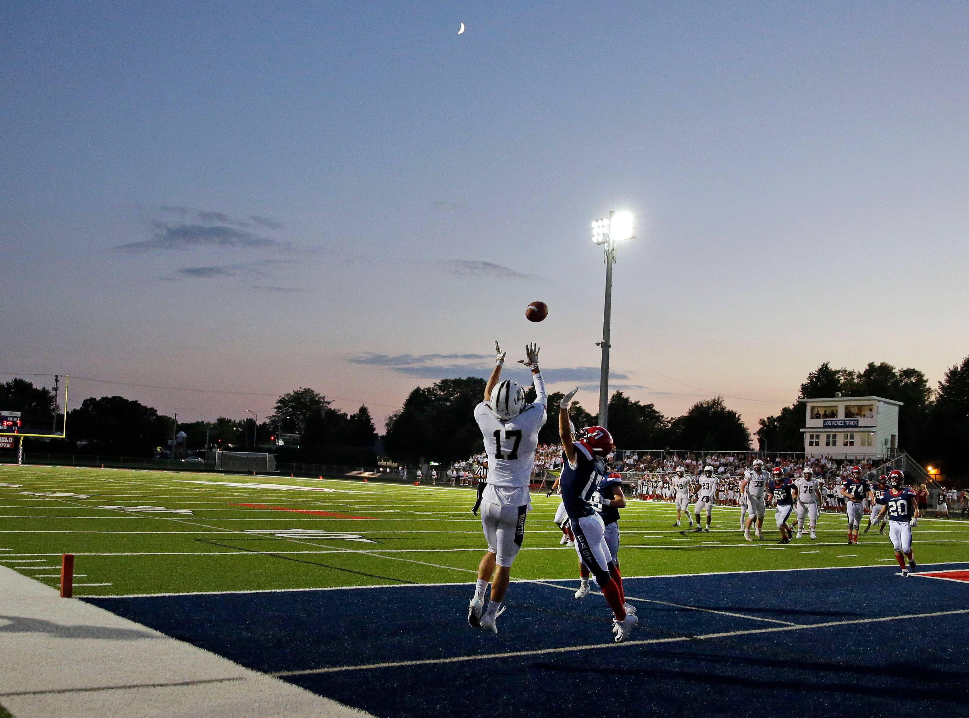 Kyle Hammen of Appleton North goes up for a touchdown catch while being defended by Ricky Thao of Appleton East in a Valley Football Association game Friday, September 14, 2018, at Appleton East High School in Appleton, Wis.Ron Page/USA TODAY NETWORK-Wisconsin