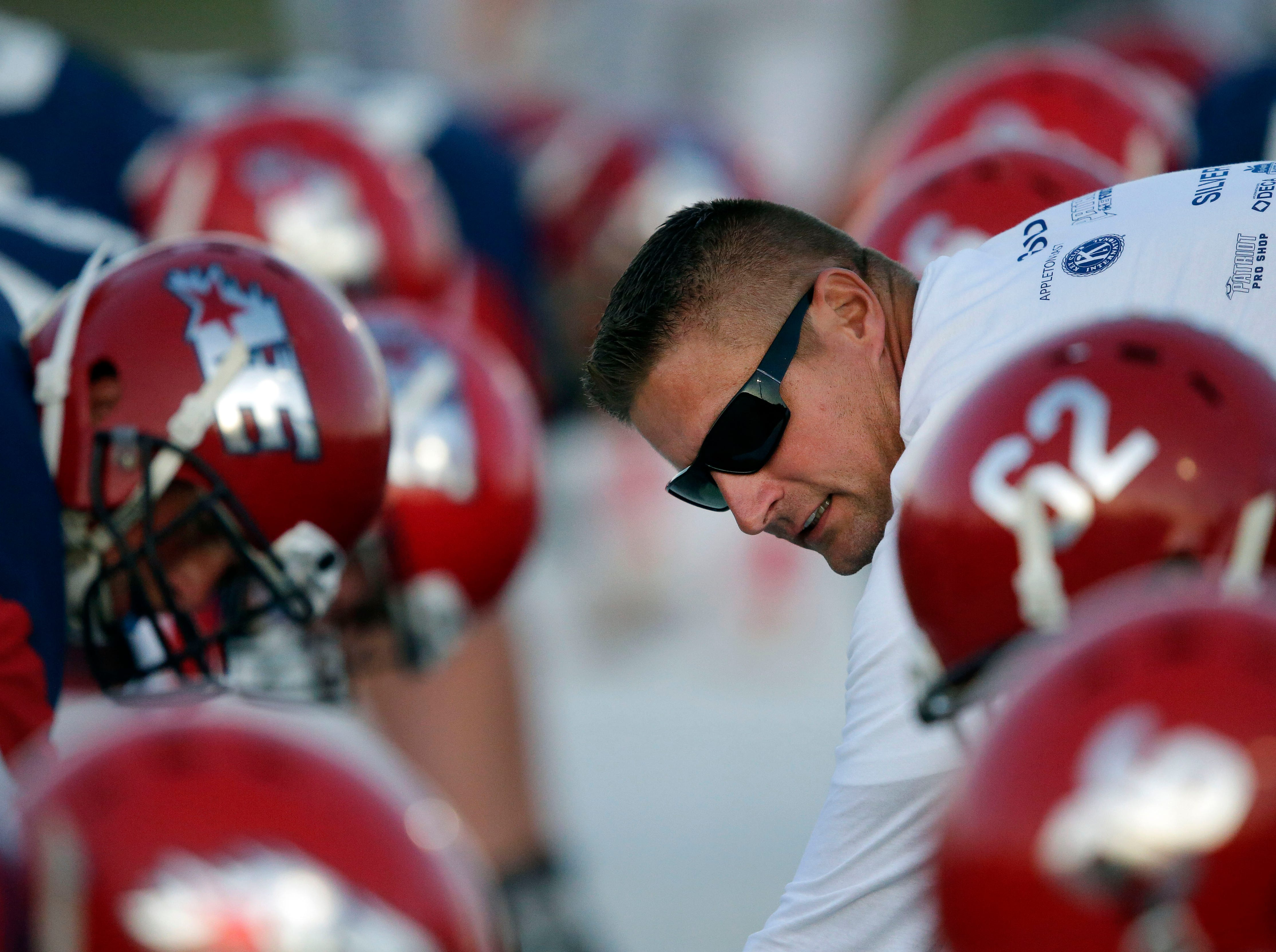 A coach leads Appleton East players through drills before taking on Appleton North in a Valley Football Association game Friday, September 14, 2018, at Appleton East High School in Appleton, Wis.Ron Page/USA TODAY NETWORK-Wisconsin