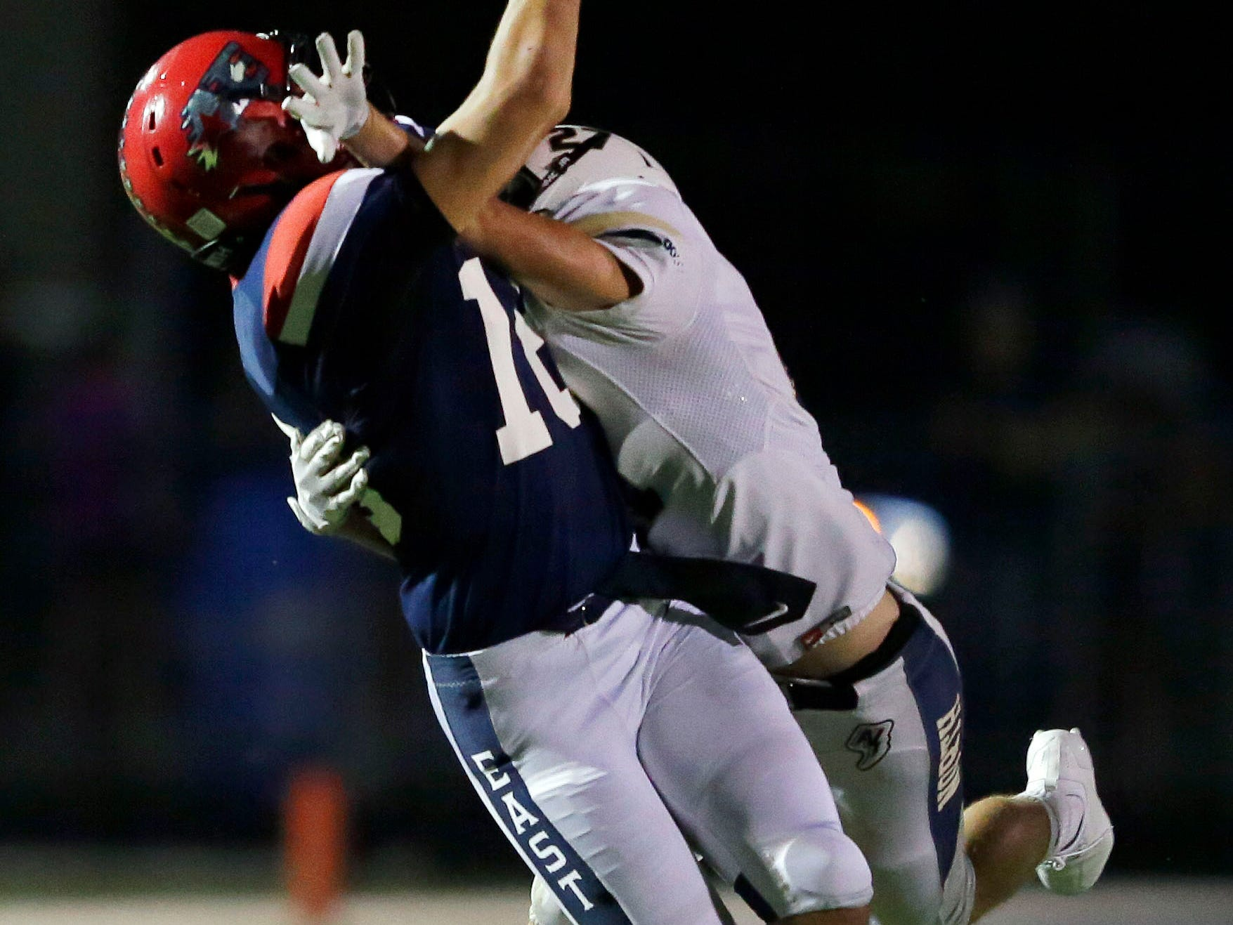 Pass interference is called on Tyler Birling of Appleton North as Spencer Meyer of Appleton East tries for a reception in a Valley Football Association game Friday, September 14, 2018, at Appleton East High School in Appleton, Wis.Ron Page/USA TODAY NETWORK-Wisconsin