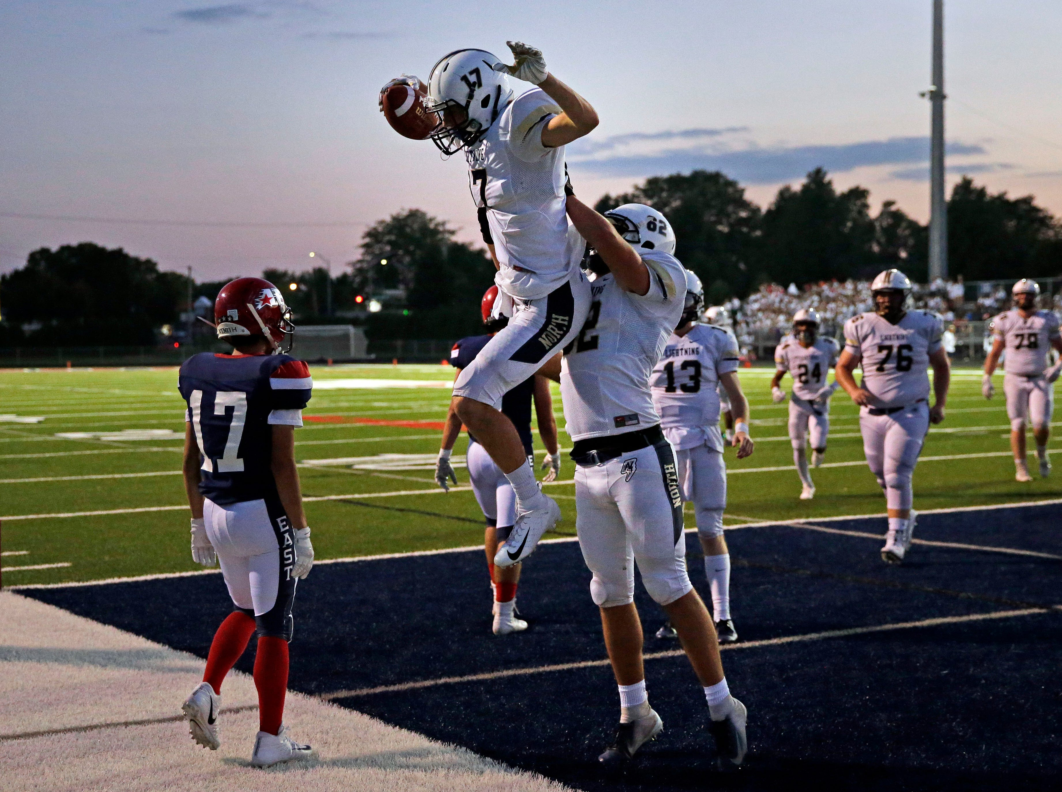 Kyle Hammen (17) and Gavin Krause of Appleton North celebrate a touchdown over Appleton East in a Valley Football Association game Friday, September 14, 2018, at Appleton East High School in Appleton, Wis.Ron Page/USA TODAY NETWORK-Wisconsin
