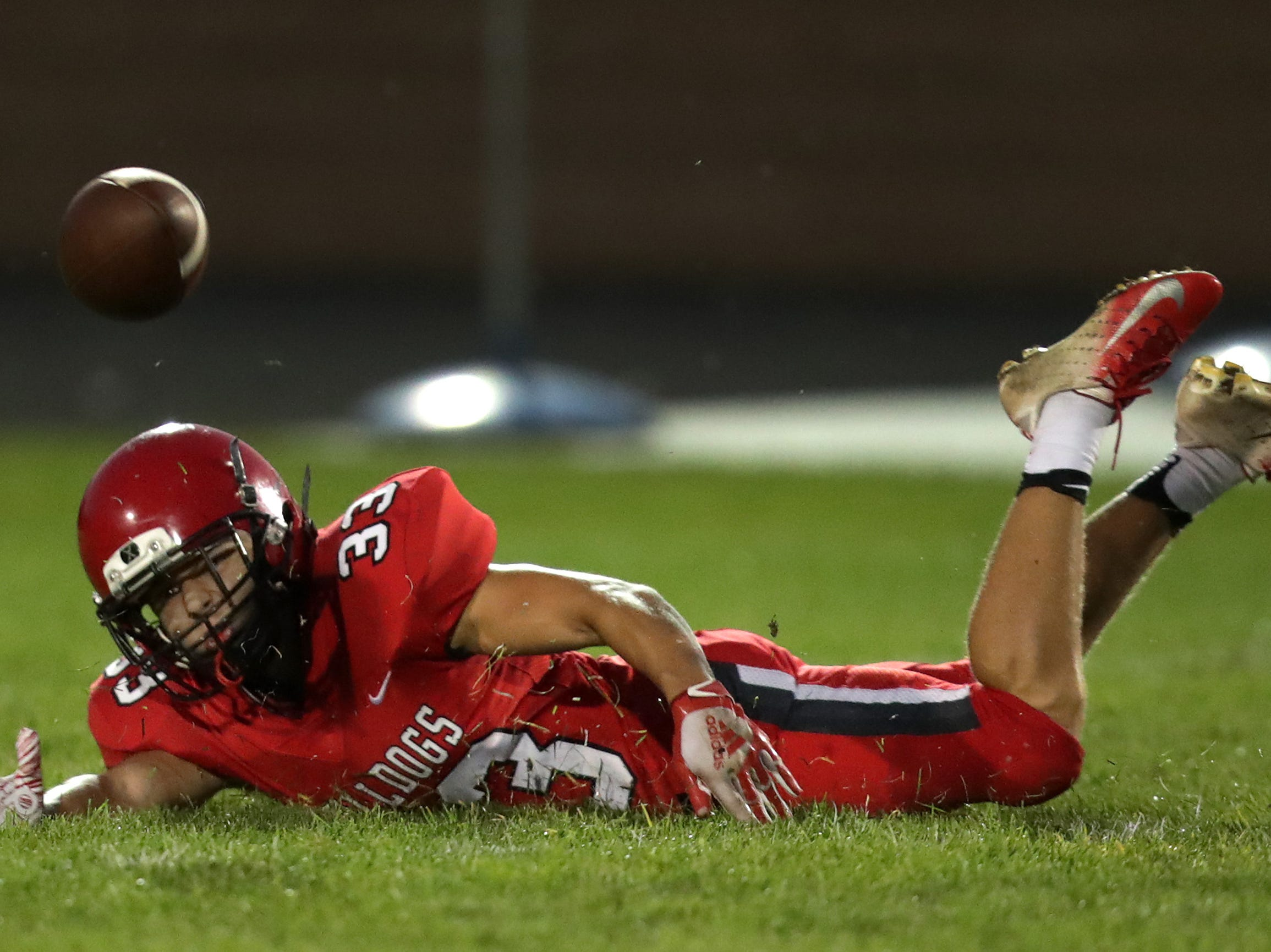 New London High School's #33 Vincent Winkler dives for a pass against Menasha High School during their football game on Friday, September 14, 2018, New London, Wis. Menasha defeated the Bulldogs 34 to 28.