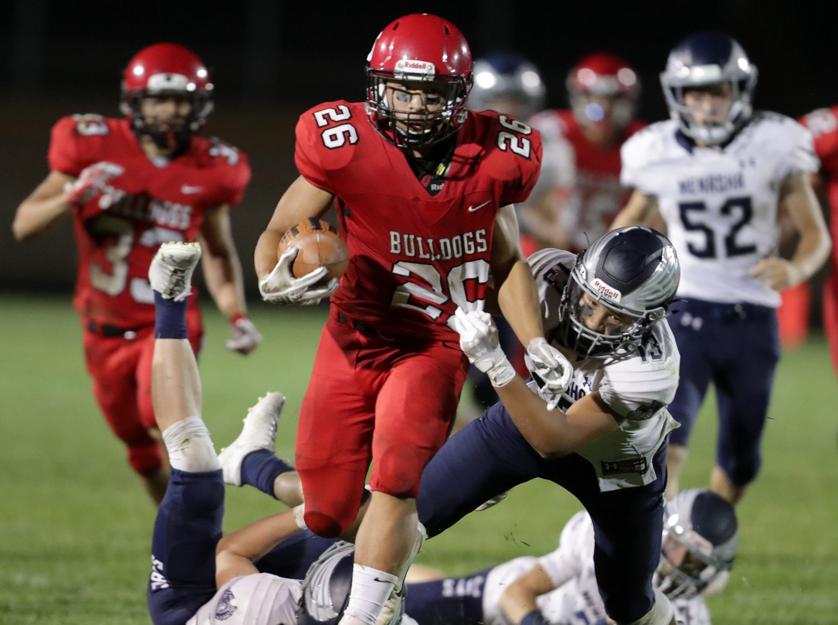 New London High School's #26 Makaio Harn against Menasha High School's #13 Leviathian during their football game on Friday, September 14, 2018, New London, Wis. Menasha defeated the Bulldogs 34 to 28.