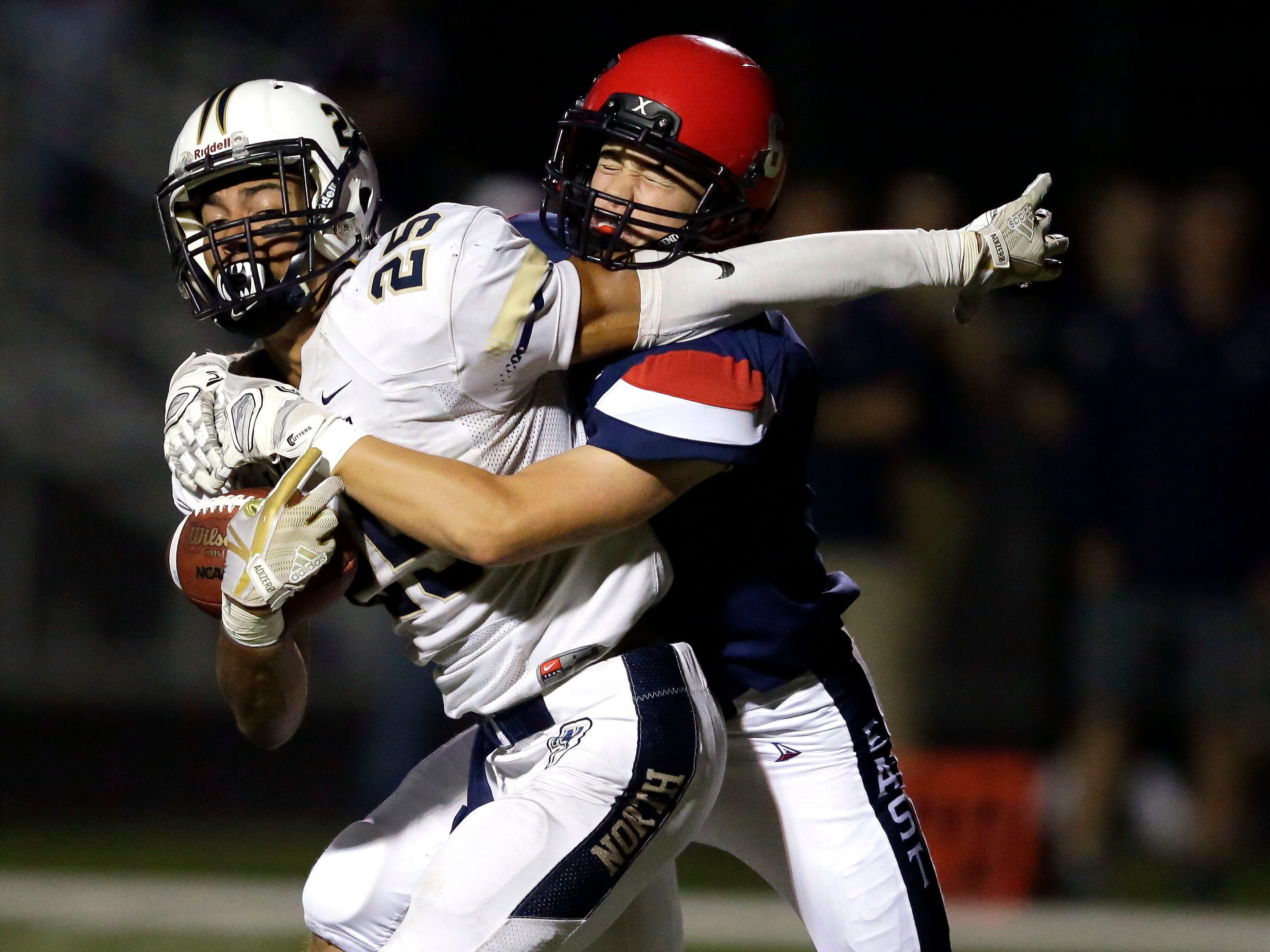 Terrell Williams of Appleton North works to get away from the Appleton East defense in a Valley Football Association game Friday, September 14, 2018, at Appleton East High School in Appleton, Wis.Ron Page/USA TODAY NETWORK-Wisconsin