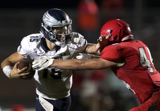 Menasha's Cole Popp runs against New London during a Bay Conference game last season. Popp is one of the state's top quarterbacks heading into the 2019 season.