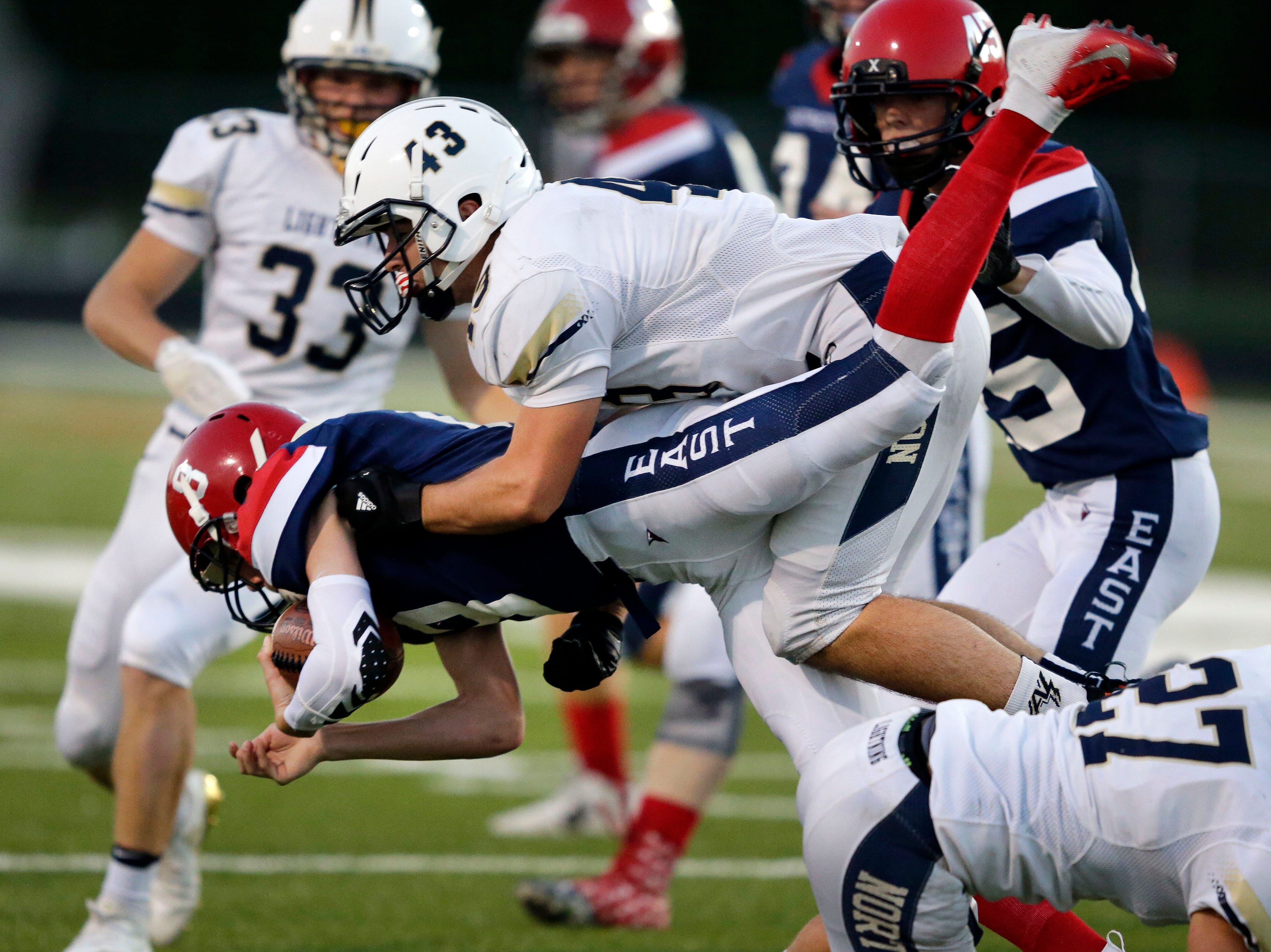 Ryan Latour of Appleton East is tackled by Nathan Smoll of Appleton North in a Valley Football Association game Friday, September 14, 2018, at Appleton East High School in Appleton, Wis.Ron Page/USA TODAY NETWORK-Wisconsin