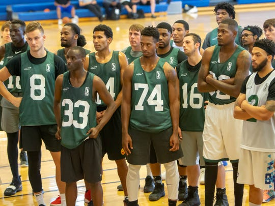 Interested players listen to instructions during a Wisconsin Herd tryout session at the Oshkosh YMCA on Saturday.