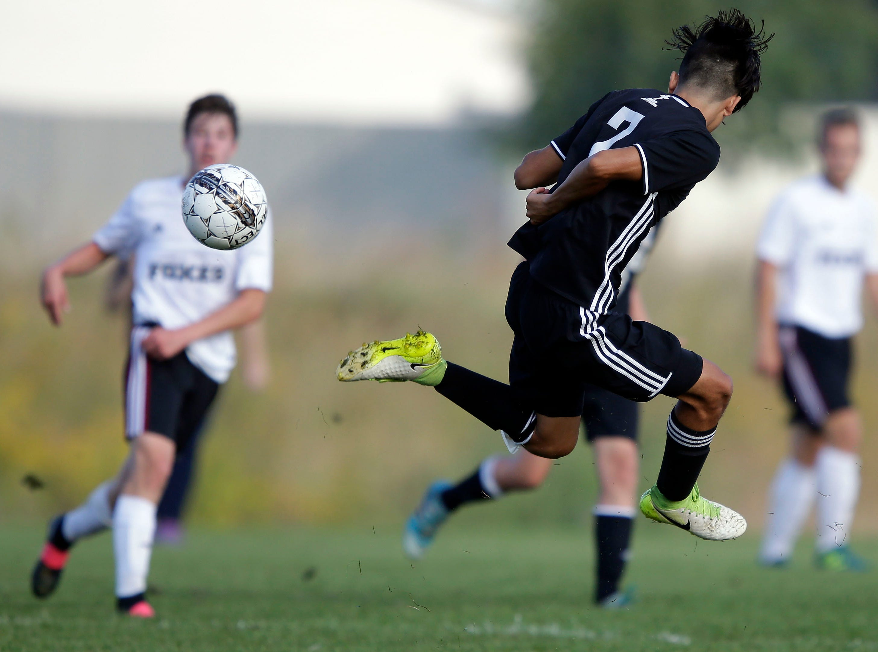 Christian Munguia of Xavier works the ball against Fox Valley Lutheran in the Xavier boys soccer tournament Saturday, September 15, 2018, at the Scheels USA Sports Complex in Appleton, Wis.