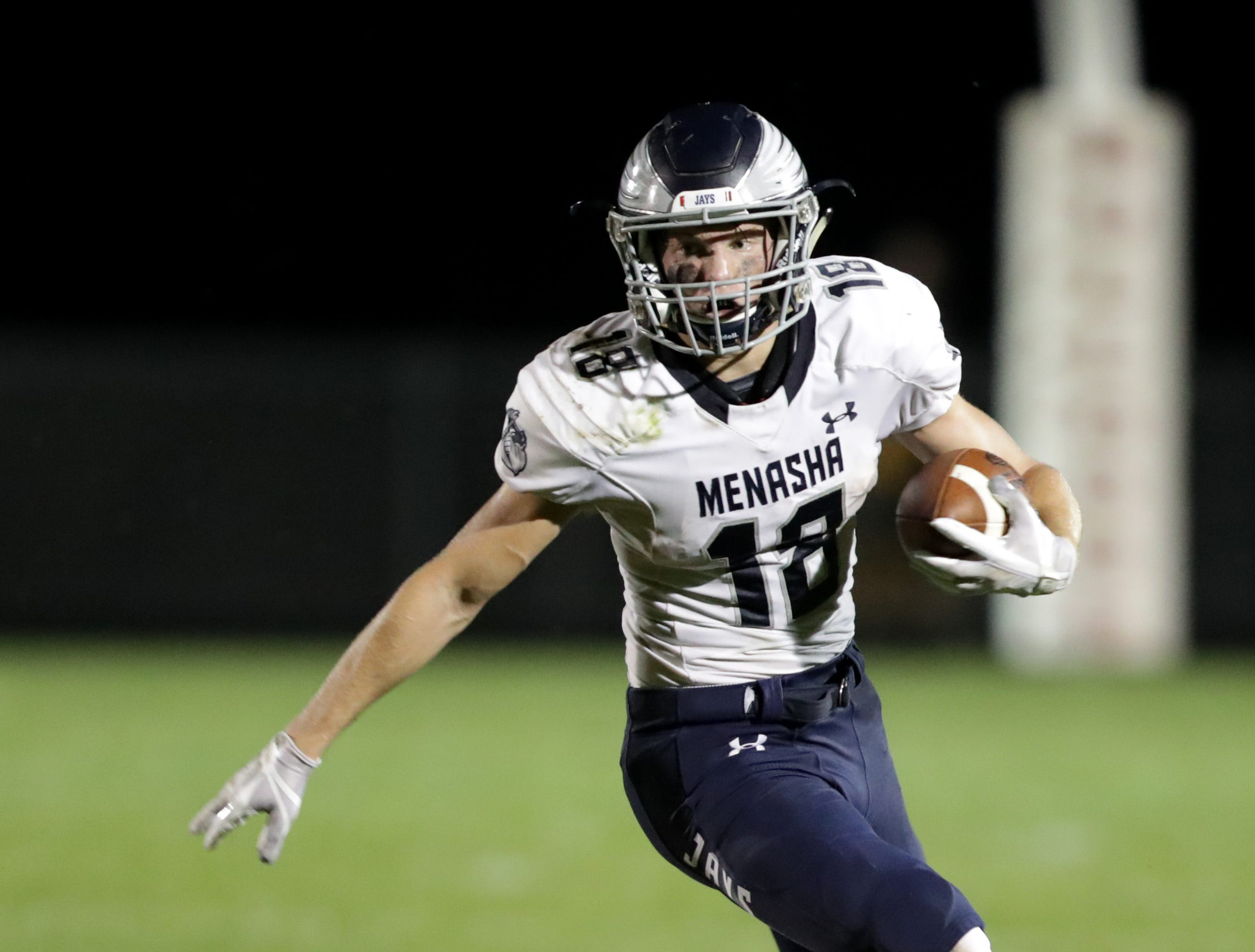 Menasha High School's #18 Riley Zirpel against New London High School's #24 Sean Cortright during their football game on Friday, September 14, 2018, New London, Wis. Menasha defeated the Bulldogs 34 to 28.