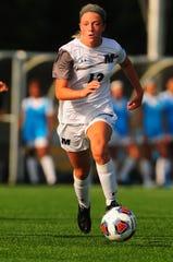 Jill Conklin dribbles for Monmouth women's soccer