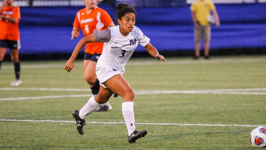 Jazlyn Moya chases the ball for Monmouth women's soccer
