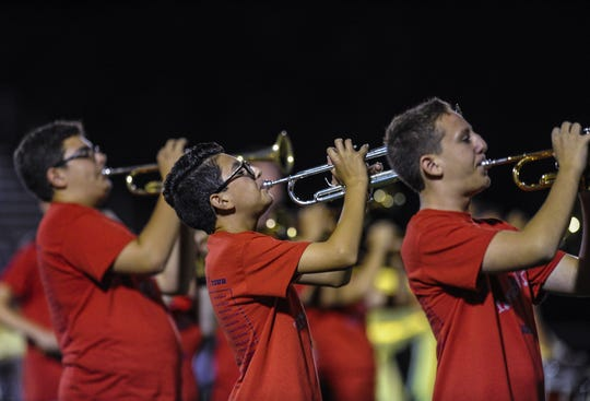 Members of the Manalapan marching band perform during halftime in the football game against Middletown South in Manalapan on Sept. 14, 2018.