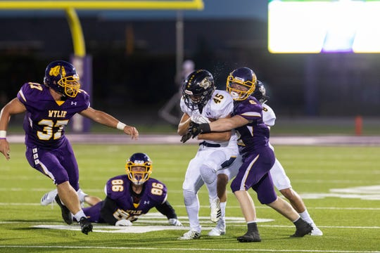 Wylie defensive back Gus Davis (2) tackles Stepheville running back Krece Nowak (45) in their nondistrict game at Bulldog Stadium.